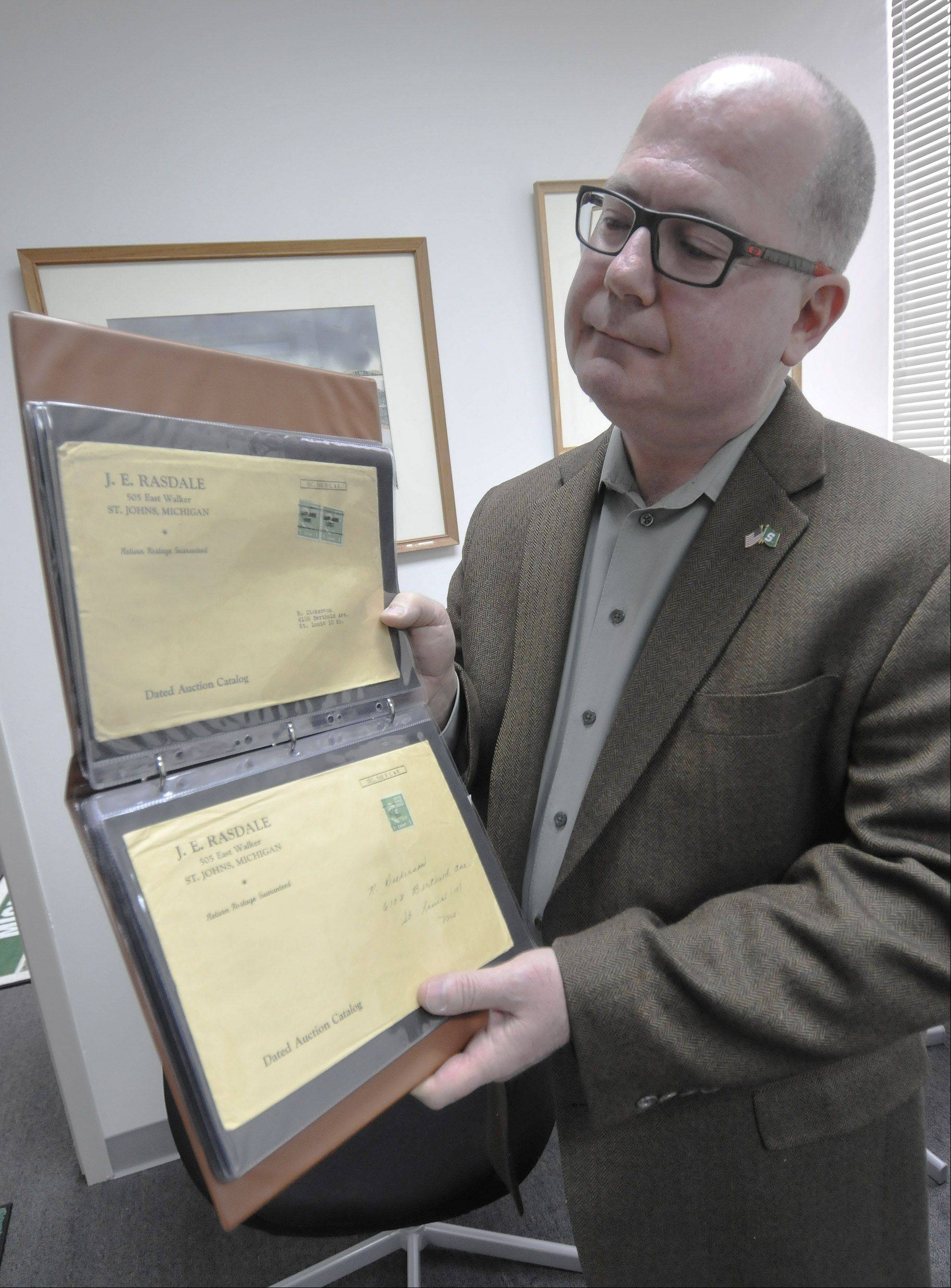 Sometimes the stamps aren't as special as the envelopes, notes Kim Kellermann, one of the owners of Rasdale Stamps in Westmont, as he displays a collection of mail addressed to his grandfather, who started the business in 1932.