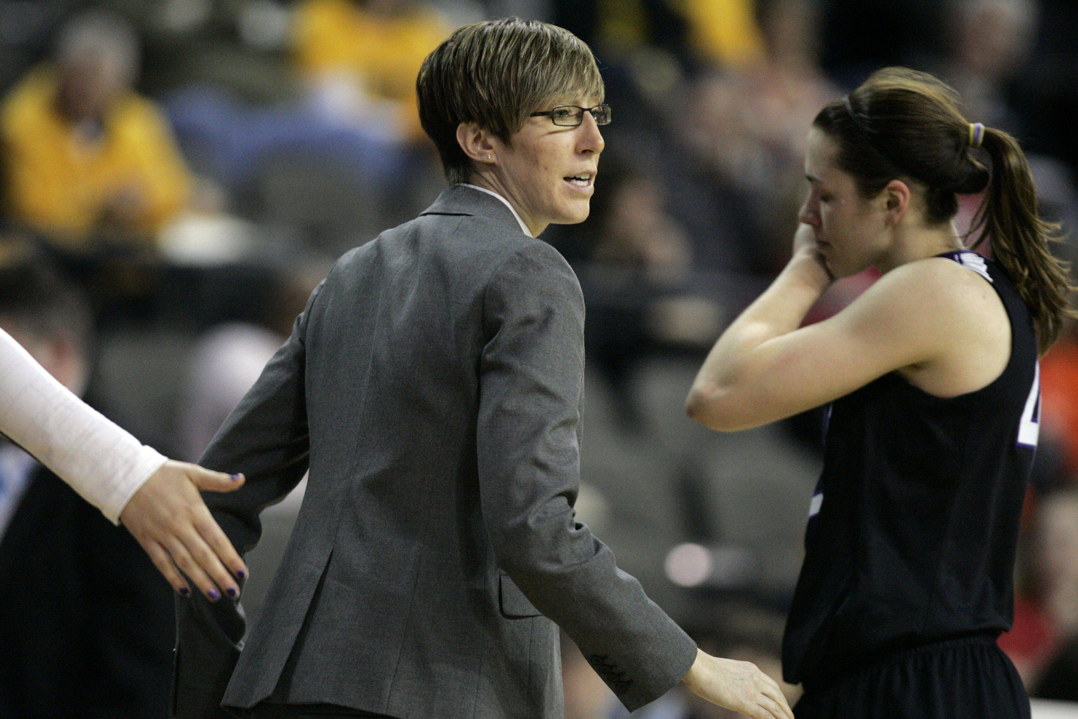 Northwestern assistant coach and former Buffalo Grove standout Allison Guth walks the sideline as the Wildcats face Iowa in the Big Ten tournament Thursday at the Sears Centre.