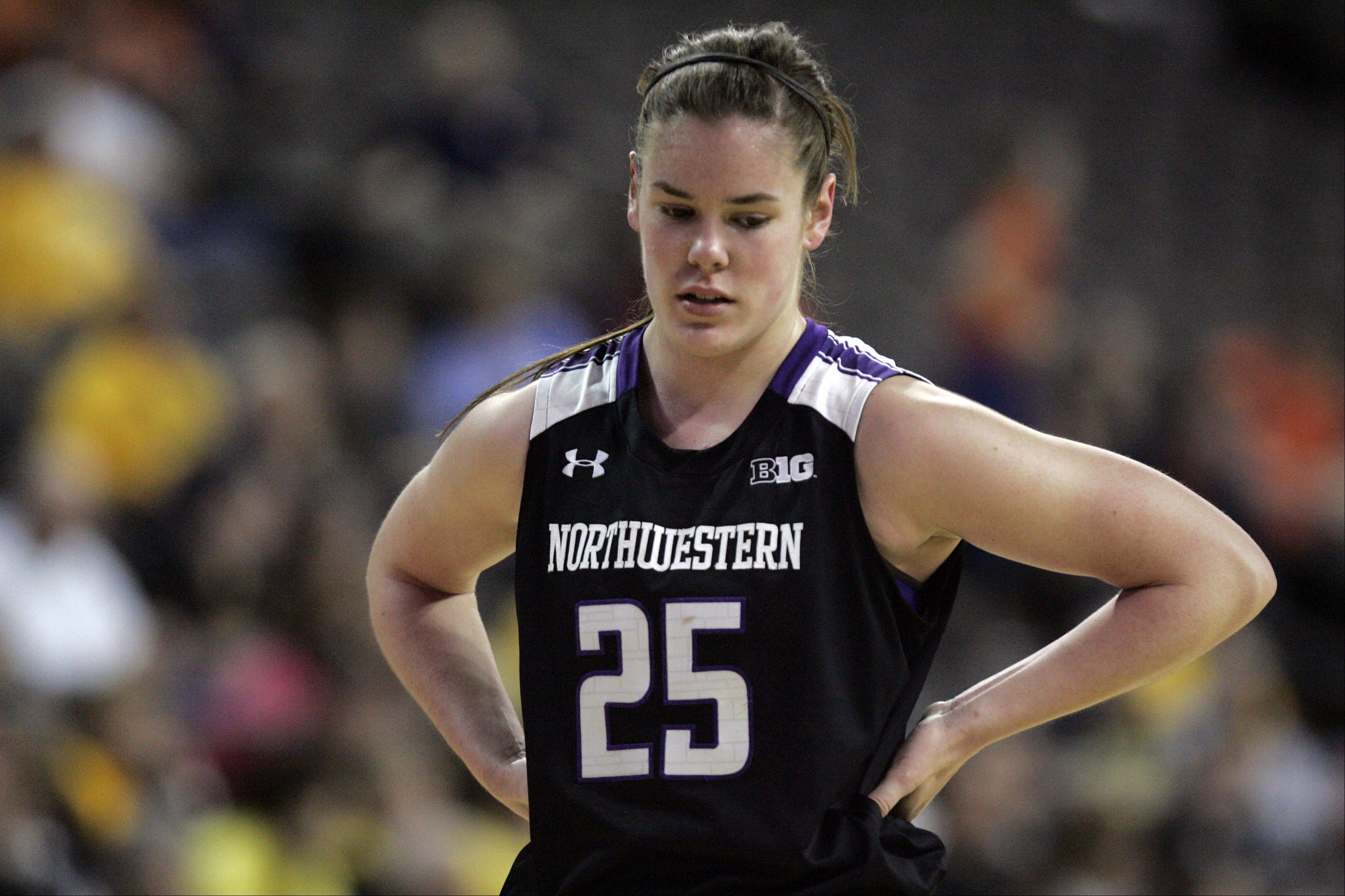 Northwestern forward Maggie Lyon (25) reacts as time winds on the Wildcats against Iowa during the Big Ten women's basketball tournament at the Sears Centre in Hoffman Estates on Thursday.