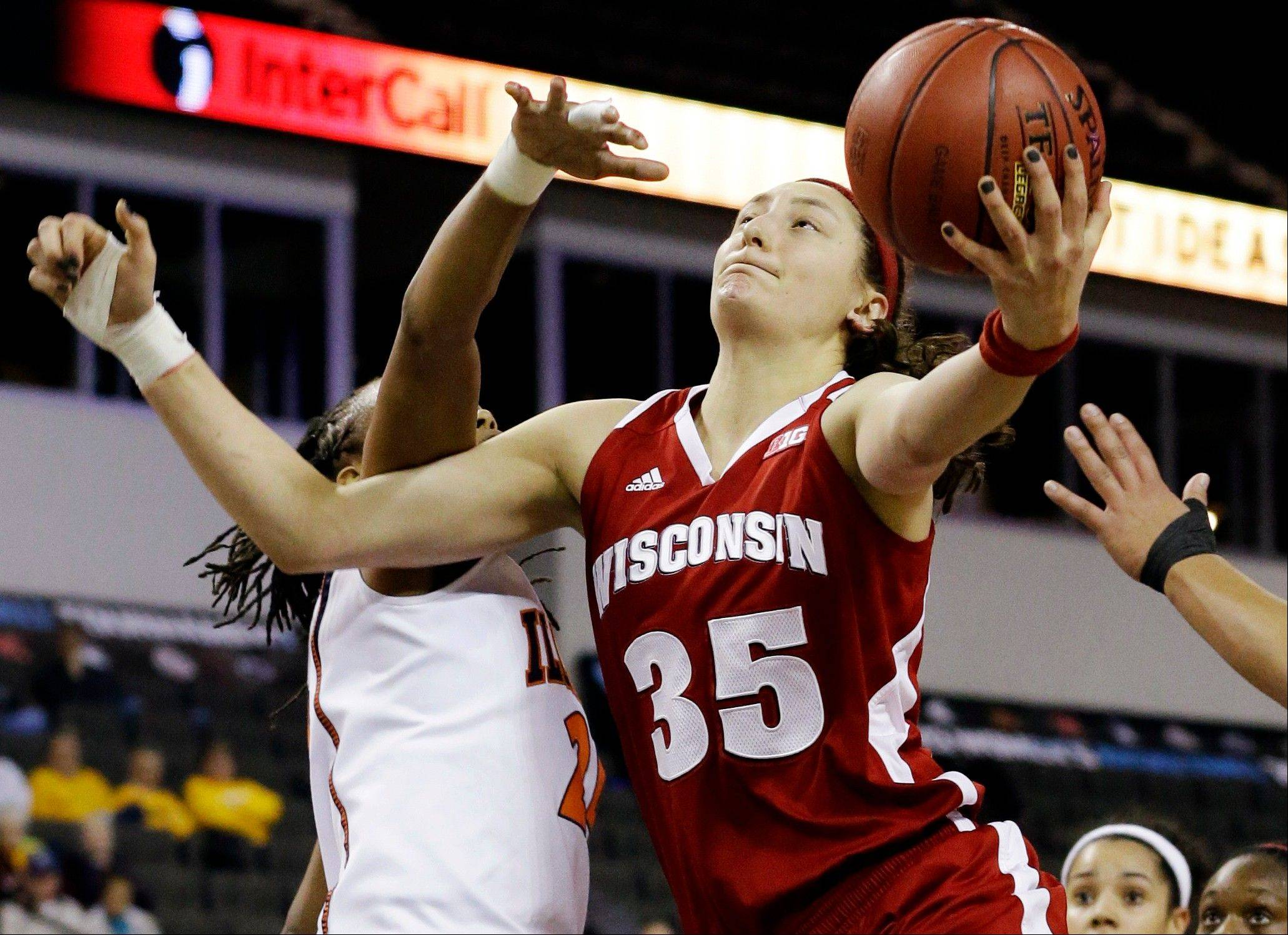 Wisconsin forward and Bartlett grad Jacki Gulczynski (35) drives to the basket against Illinois guard Tiera Stephen during the first half of an NCAA college basketball game in the Big Ten Conference tournament in Hoffman Estates, Ill., Thursday, March 7, 2013. Wisconsin won 58-57.