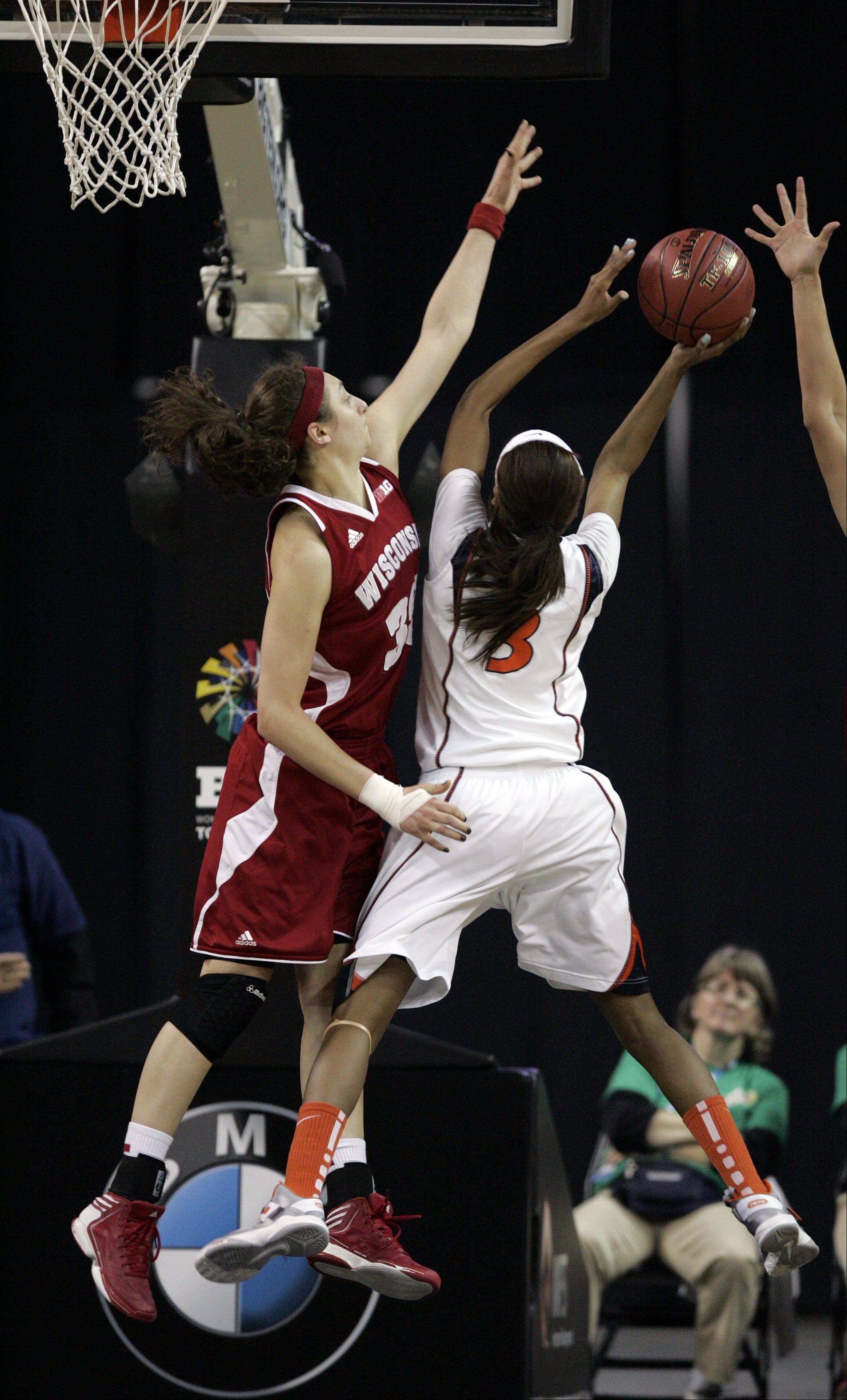 Jacki Gulczynski of Wisconsin pressures Illini guard/forward Taylor Tuck during action Thursday at the Big Ten Women's Basketball Tournament at the Sears Centre in Hoffman Estates. Wisconsin advanced with a 58-57 win.