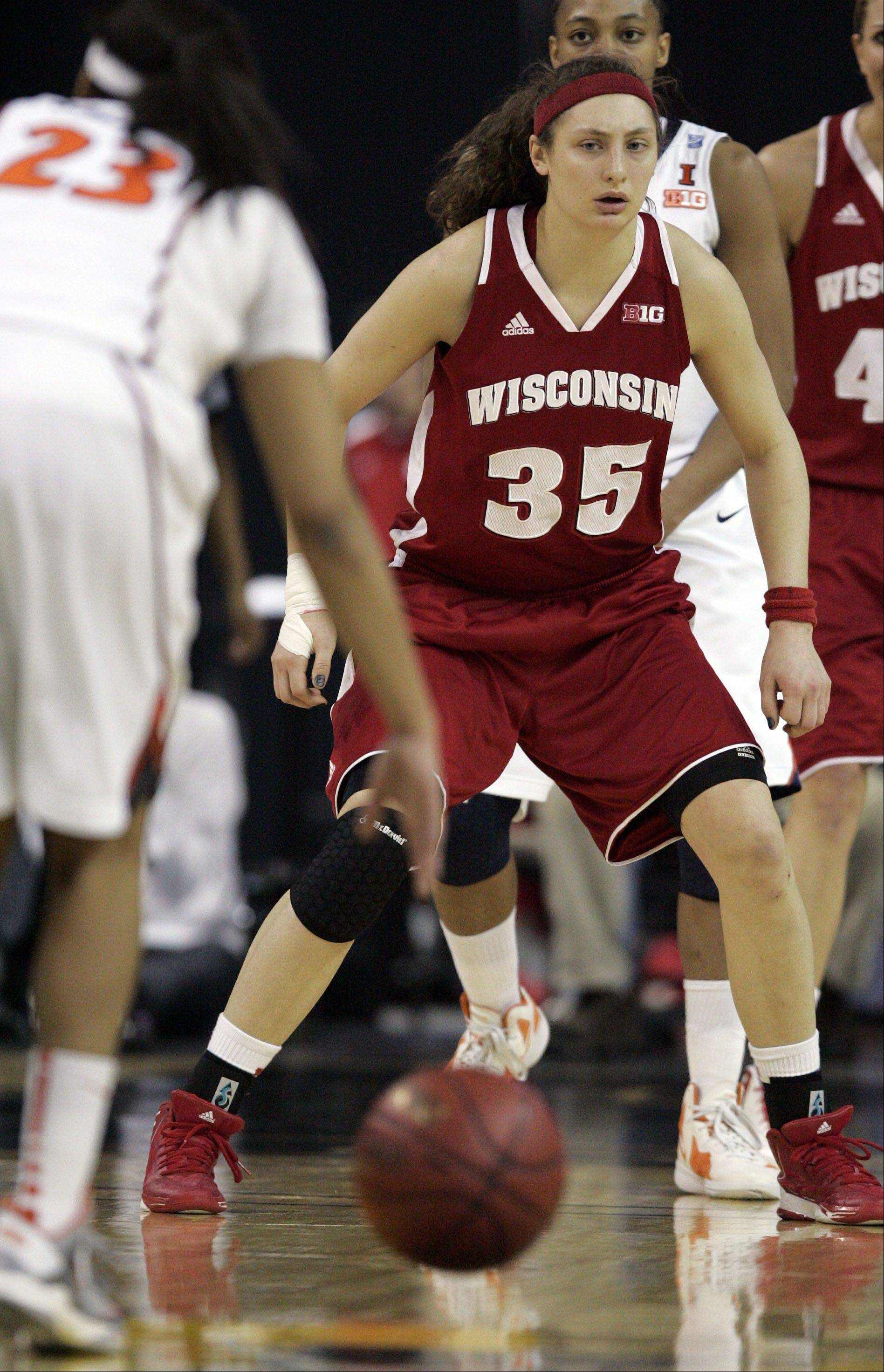 Wisconsin Badgers forward Jacki Gulczynski (35) keeps an eye on the ball during action Thursday at the Big Ten Women's Basketball Tournament at the Sears Centre in Hoffman Estates. Wisconsin advanced with a 58-57 win.