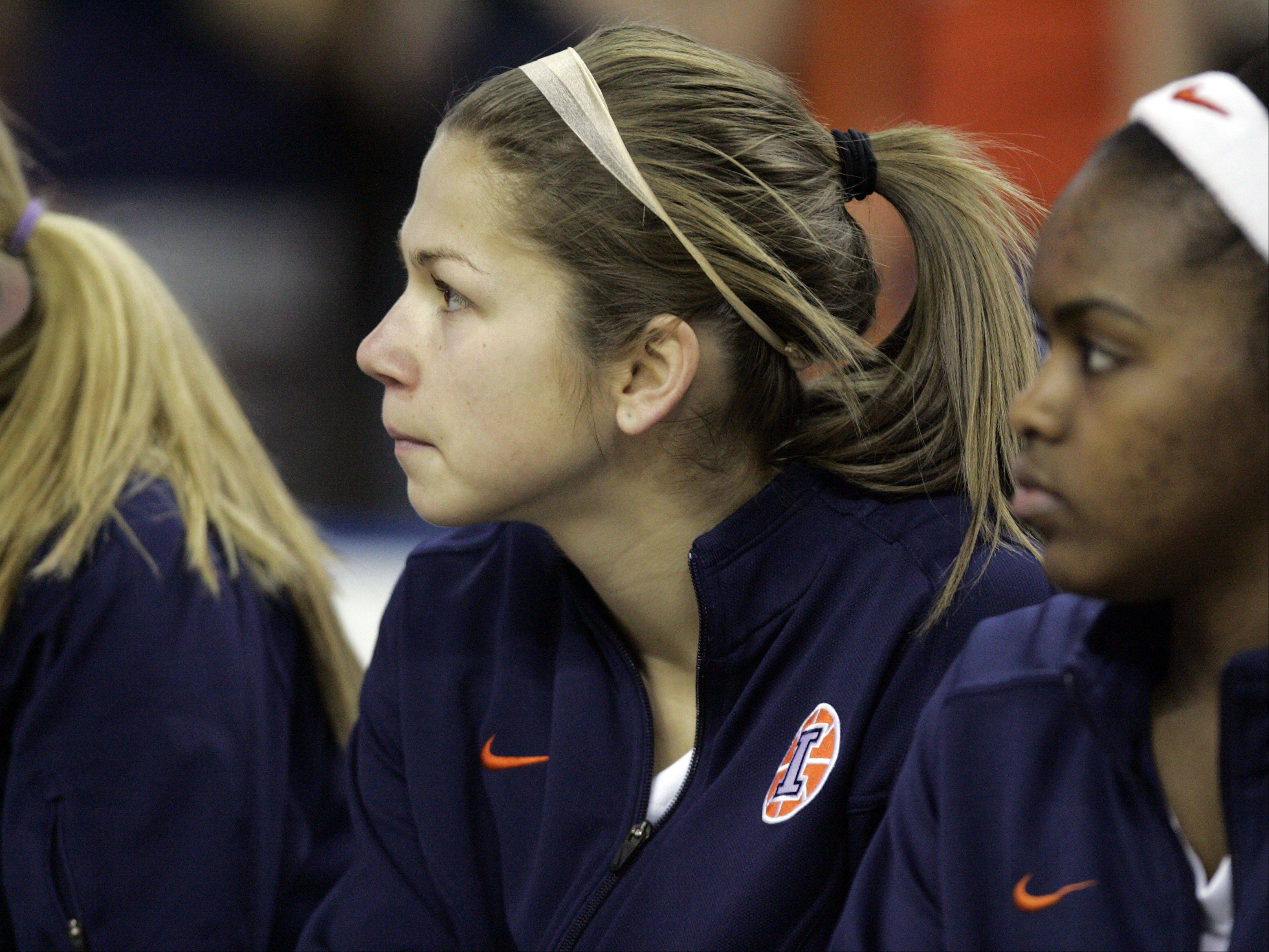 Illini guard Cassie Dumoulin watches from the bench during action Thursday at the Big Ten Women's Basketball Tournament at the Sears Centre in Hoffman Estates. Wisconsin advanced with a 58-57 win.