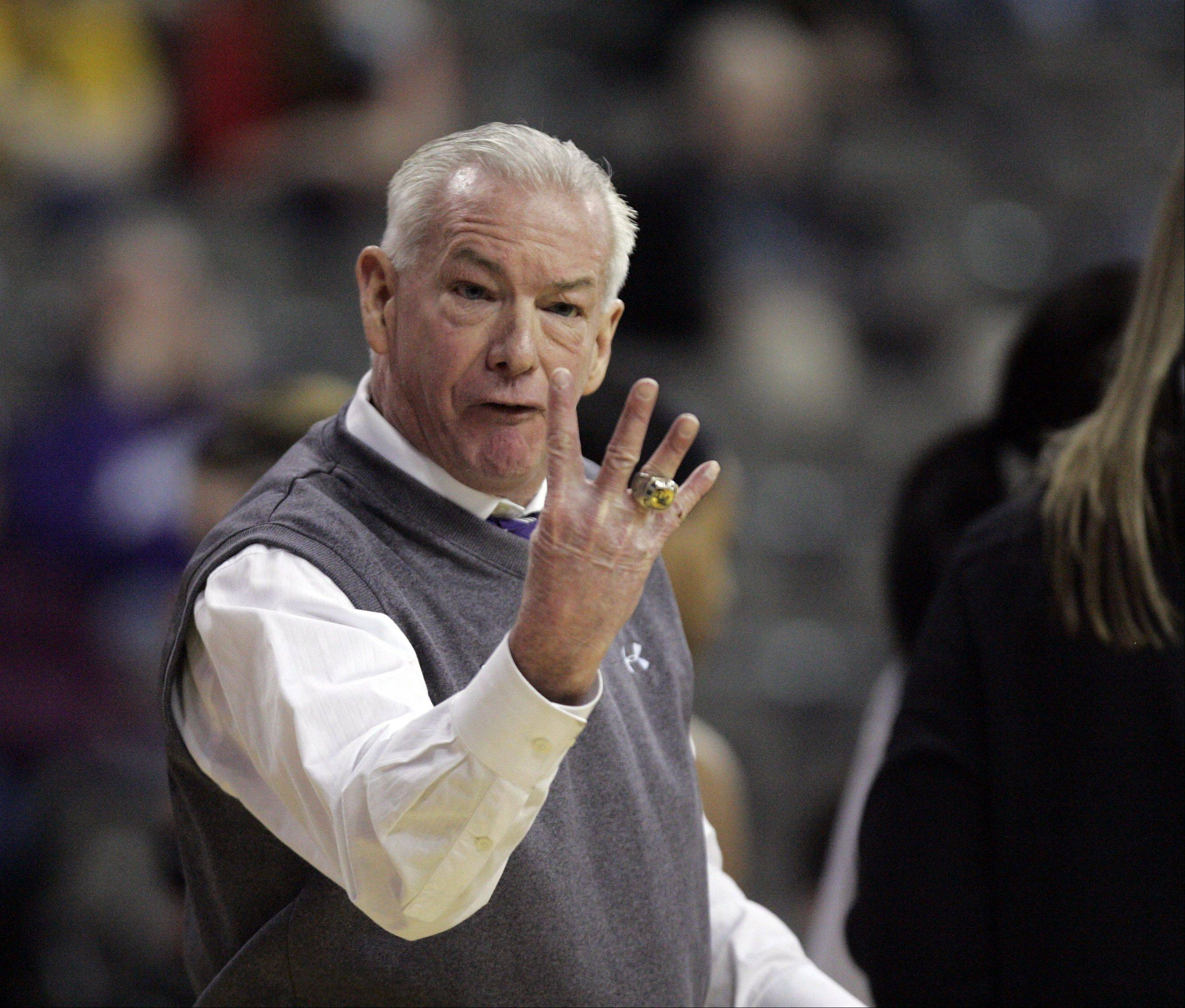 Northwestern head coach Joe McKeown make a point to an official at the Big Ten Women's Basketball Tournament at the Sears Centre in Hoffman Estates. Iowa defeated Northwestern 60-55 to advance.