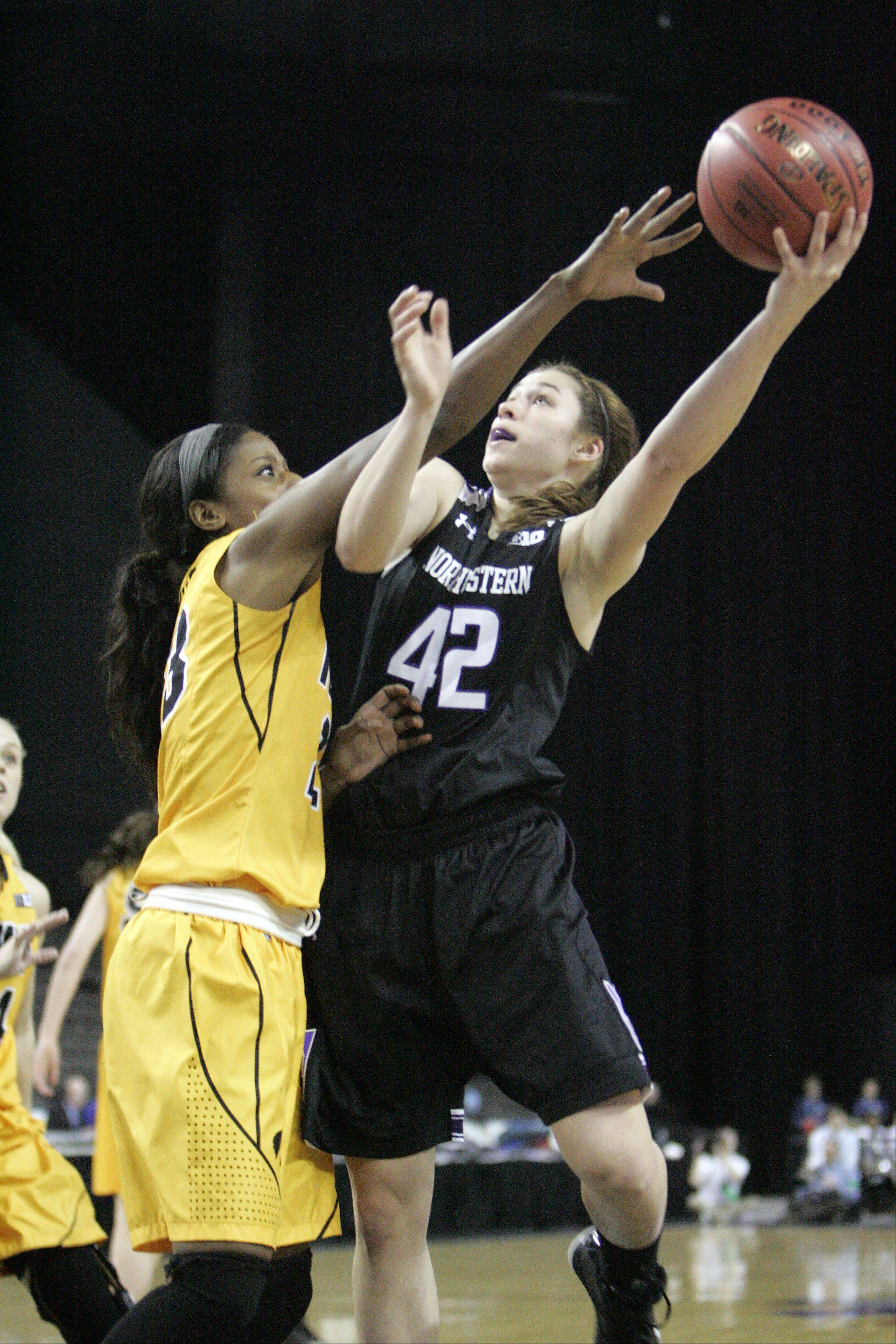 Iowa guard Theairra Taylor (23) pressures Northwestern guard Karly Roser at the Big Ten Women's Basketball Tournament at the Sears Centre in Hoffman Estates. Iowa defeated Northwestern and will play Nebraska on Friday.