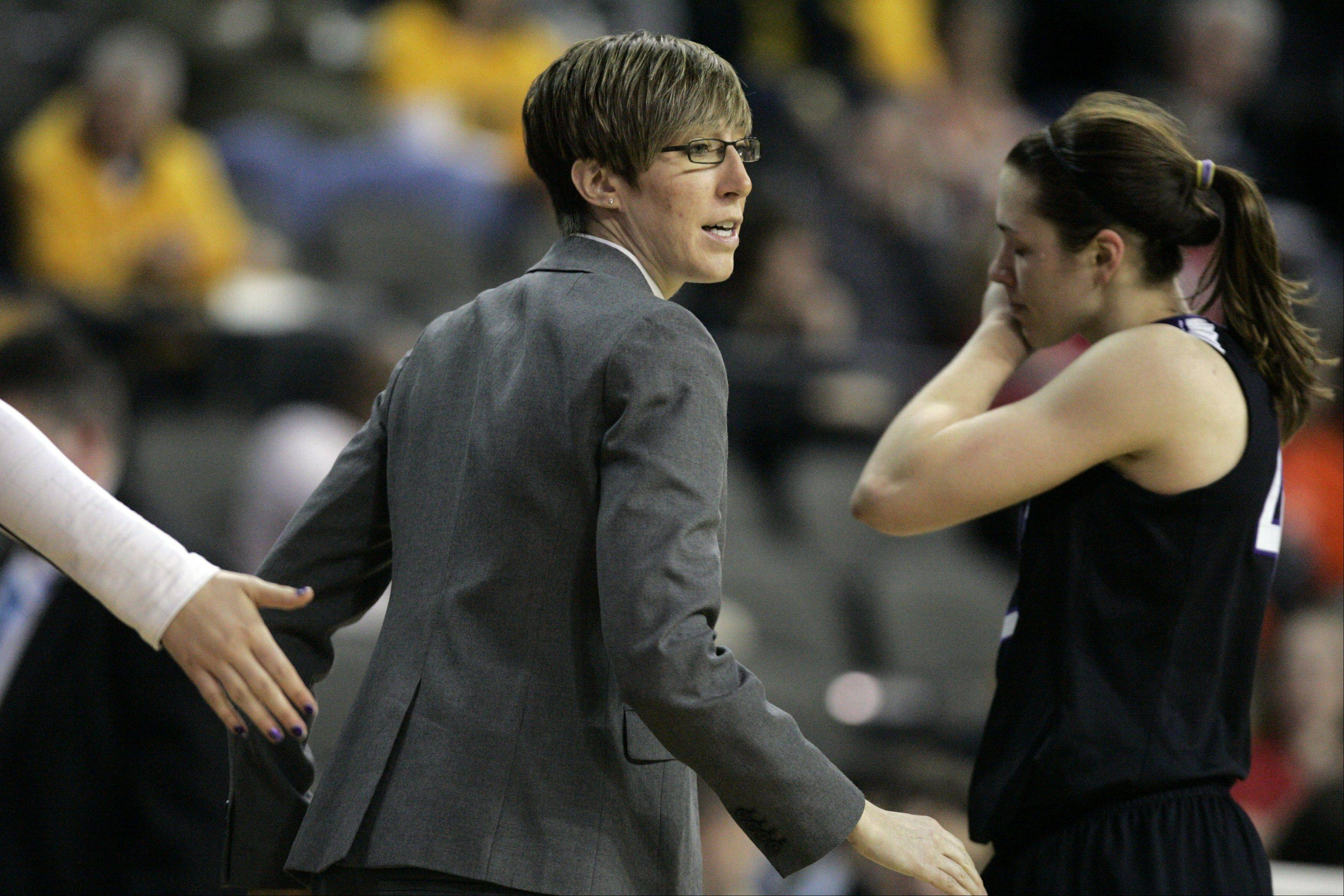 Northwestern assistant coach Allison Guth talks to her team during action Thursday at the Big Ten Women's Basketball Tournament at the Sears Centre.