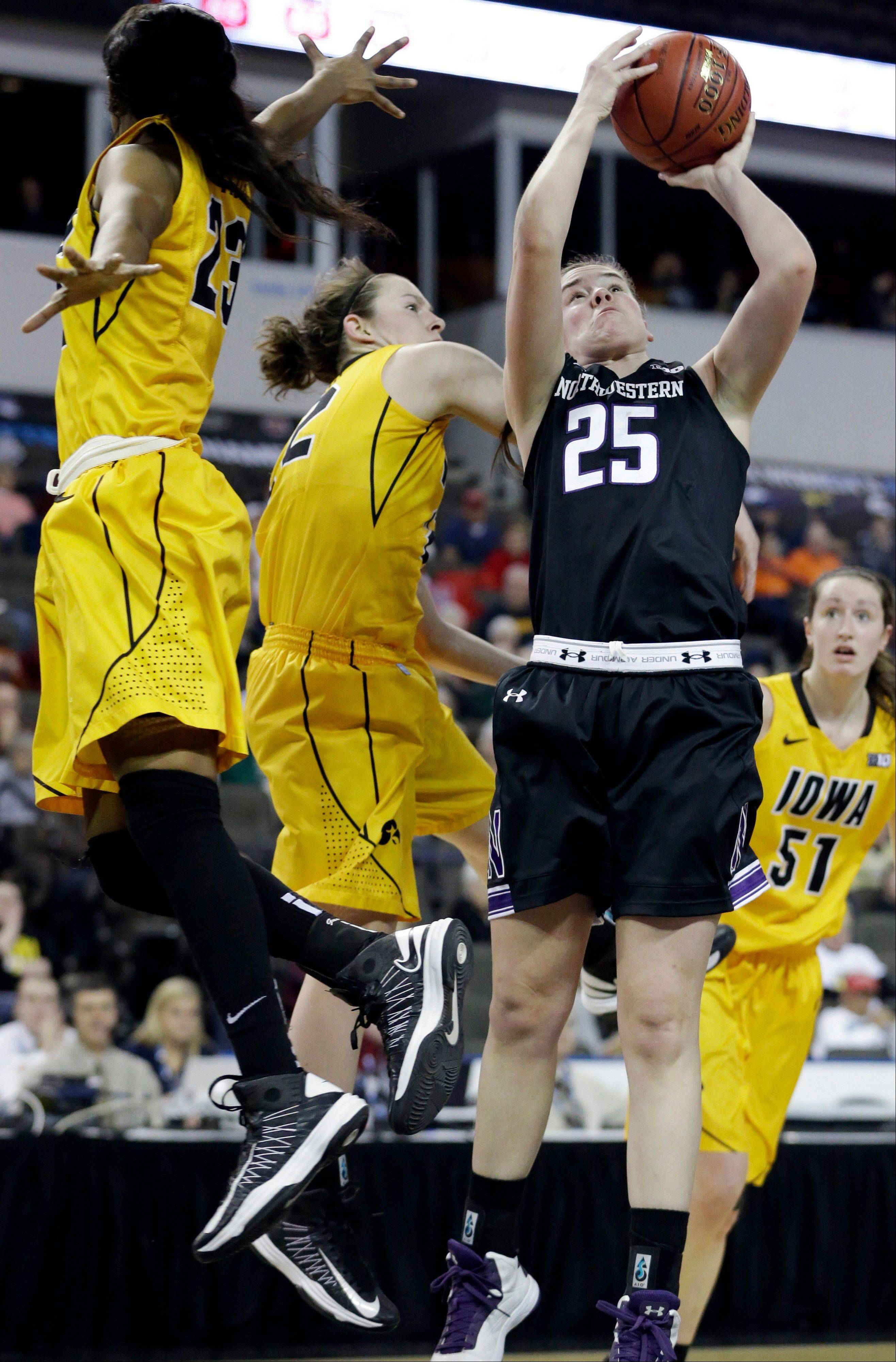 Northwestern forward Maggie Lyon shoots past Iowa guard Theairra Taylor, left, and guard Samamtha Logic Thursday during first-half action at the Big Ten Women's Basketball Tournament at the Sears Centre in Hoffman Estates.
