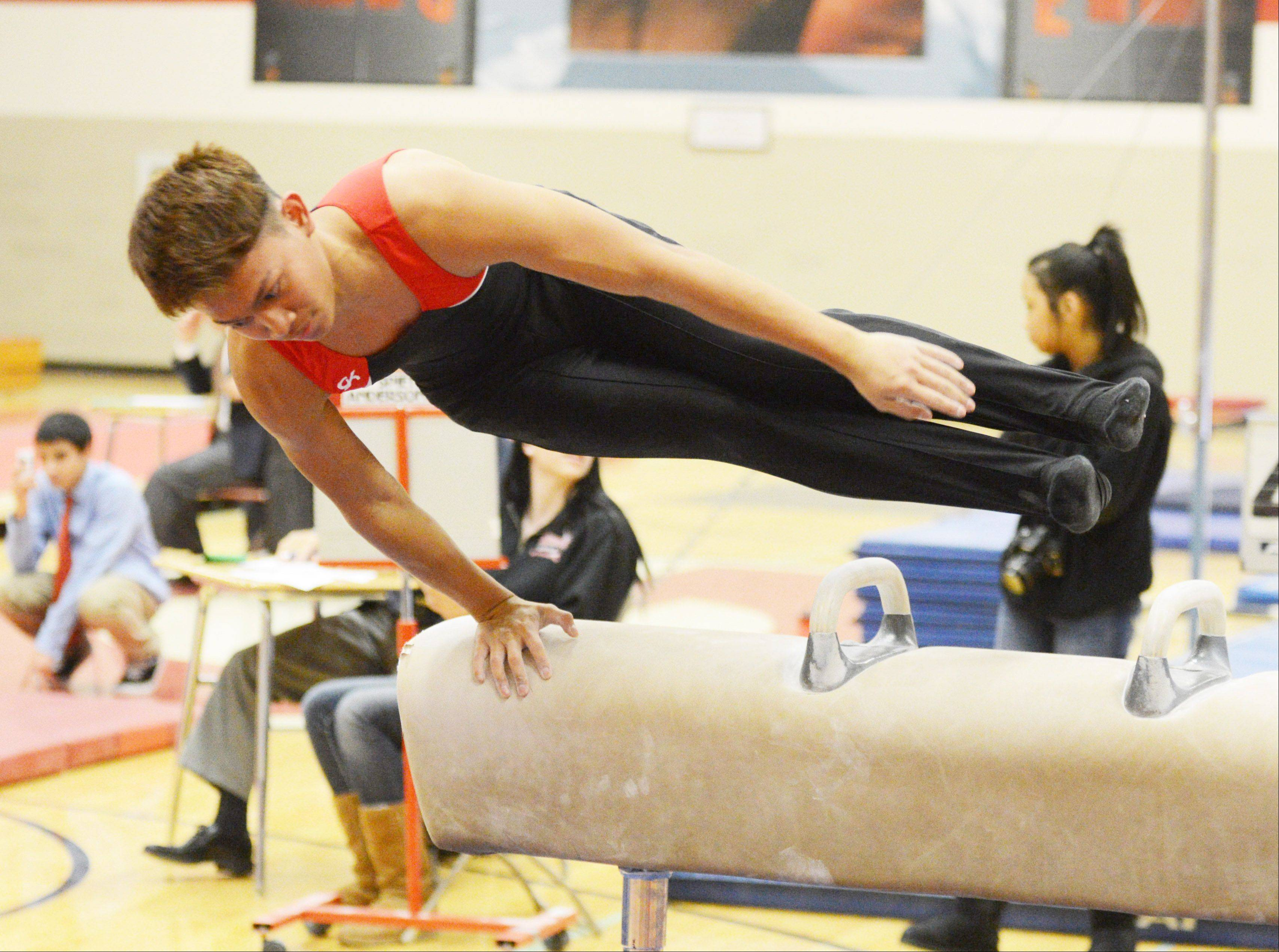 Melik Prum of Glenbard East on the horse during the District 87 boys gymnastics invitational at Glenbard East Thursday.