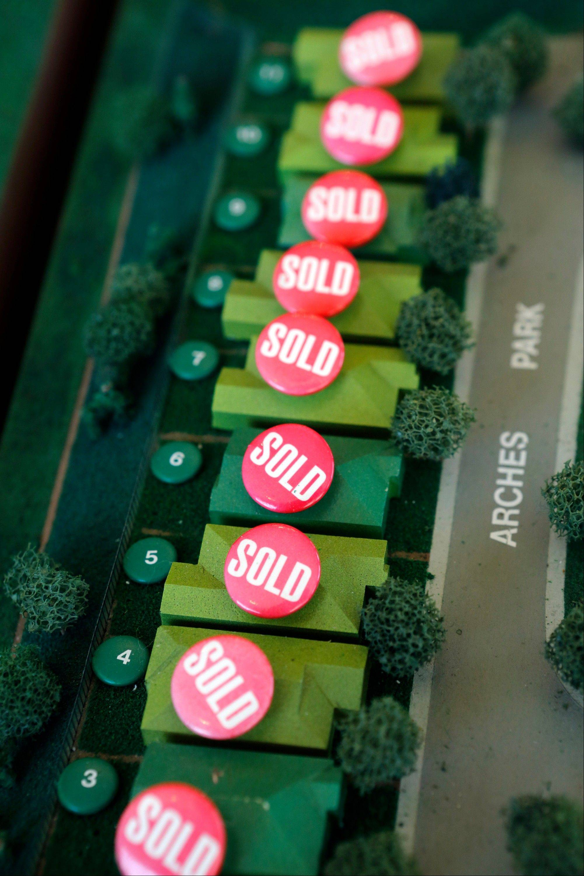 Homes that have been sold are marked with buttons on a model in the sales office of Hovnanian Enterprises Inc.�s Four Seasons housing development in Beaumont, California.