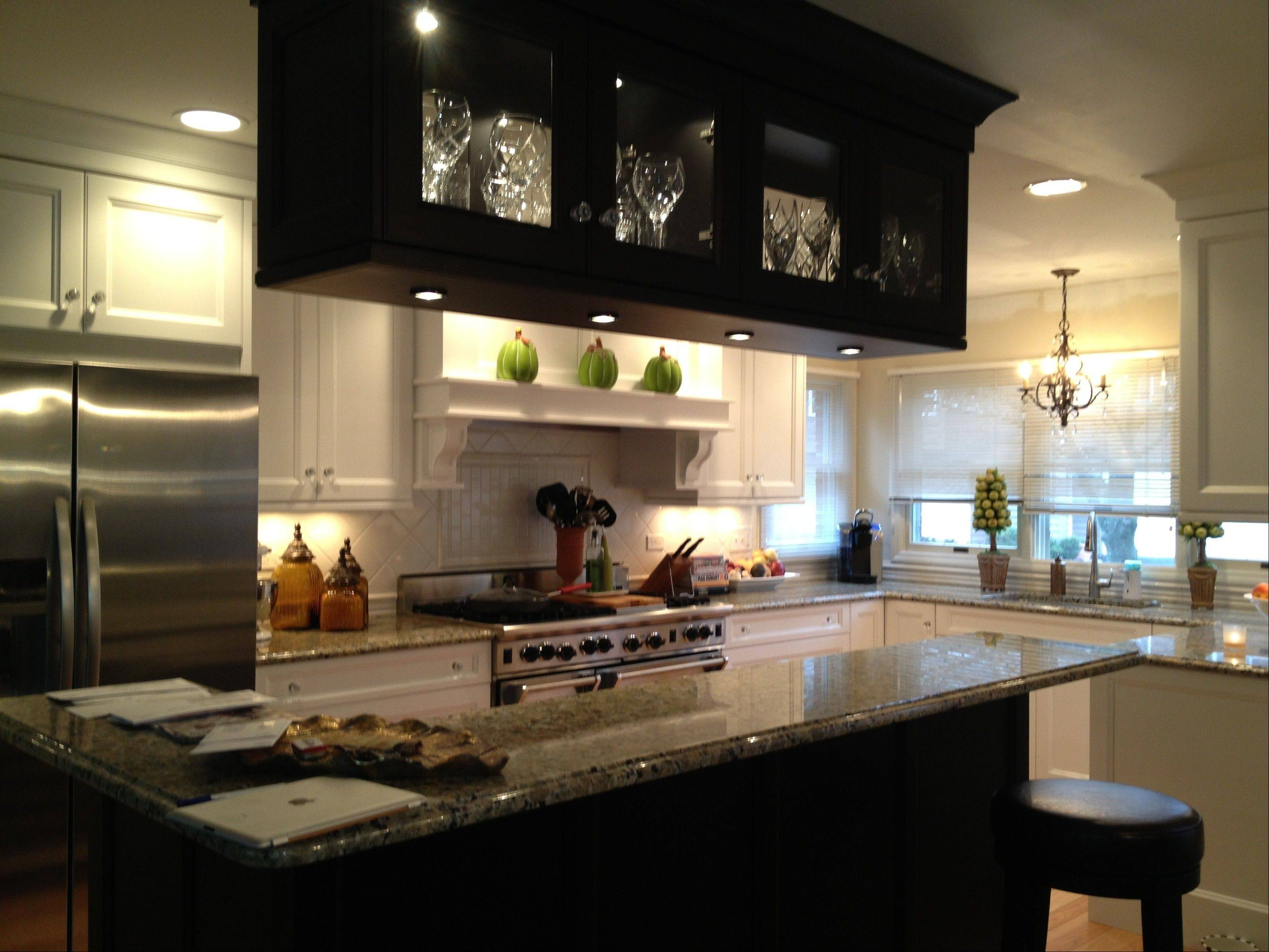 Contrasting light and dark cabinets and glass-fronted doors with cabinet lighting are popular today.
