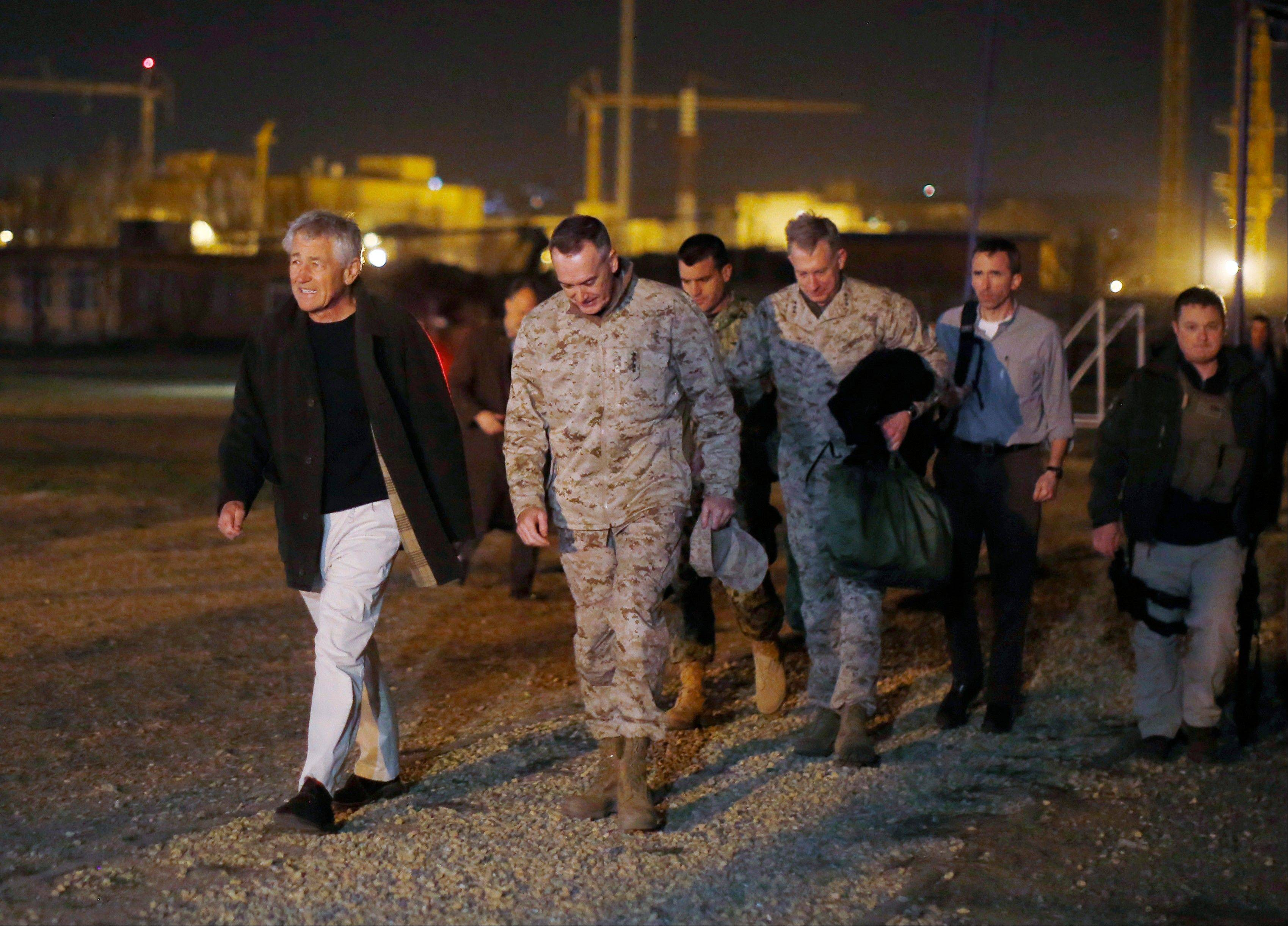 Defense Secretary Chuck Hagel walks Friday with U.S. Marine General Joseph Dunford, commander of the International Security Force, upon Hagel�s arrival near Camp Eggers in Kabul, Afghanistan.
