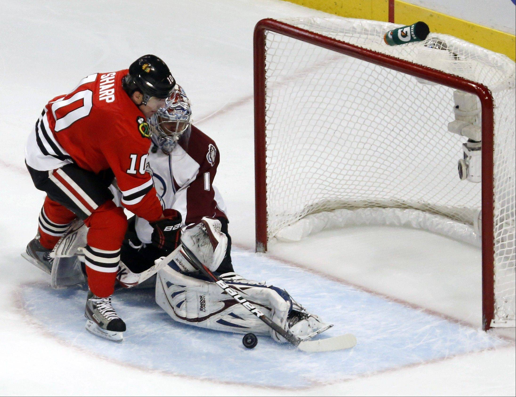 Colorado Avalanche goalie Semyon Varlamov (1), of Russia, makes a save on a shot by Chicago Blackhawks center Patrick Sharp during the second period of an NHL hockey game, Wednesday, March 6, 2013, in Chicago.