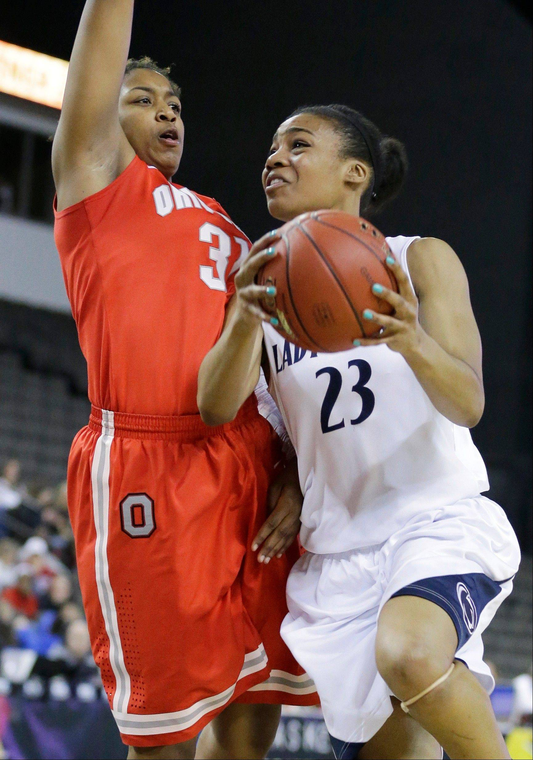 Penn State forward Ariel Edwards, right, drives to the basket against Ohio State guard Raven Ferguson during the second half of an NCAA women's college basketball game in the Big Ten Conference tournament in Hoffman Estates, Ill., on Friday, March 8, 2013. Penn State won 76-66. (AP Photo/Nam Y. Huh)