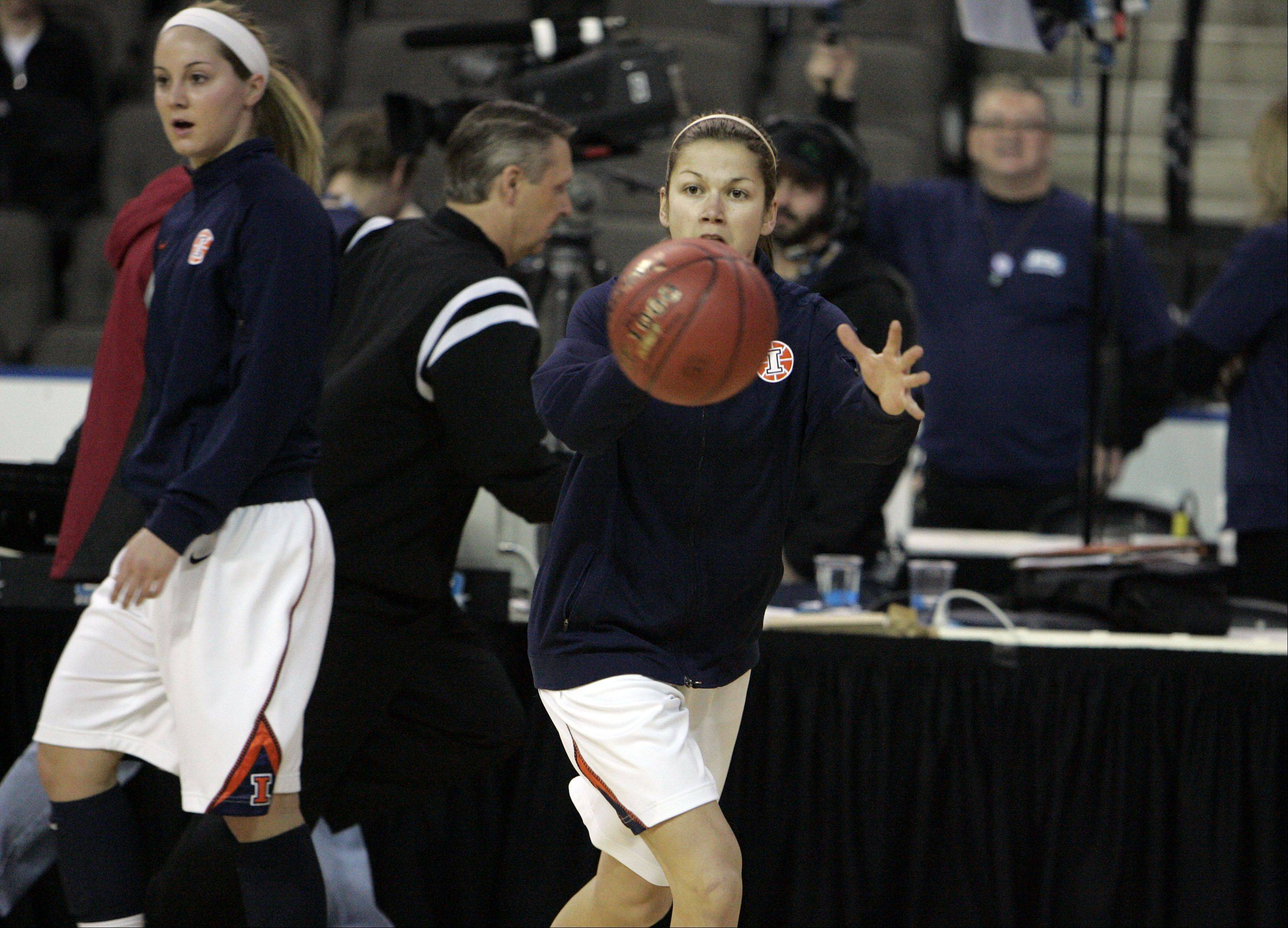 Hampshire and ECC graduate Cassie Dumoulin, who played at Illinois this season, passes the ball in warm-ups prior to the Illini�s loss to Wisconsin Thursday at the Big Ten women�s basketball tournament at the Sears Centre in Hoffman Estates.
