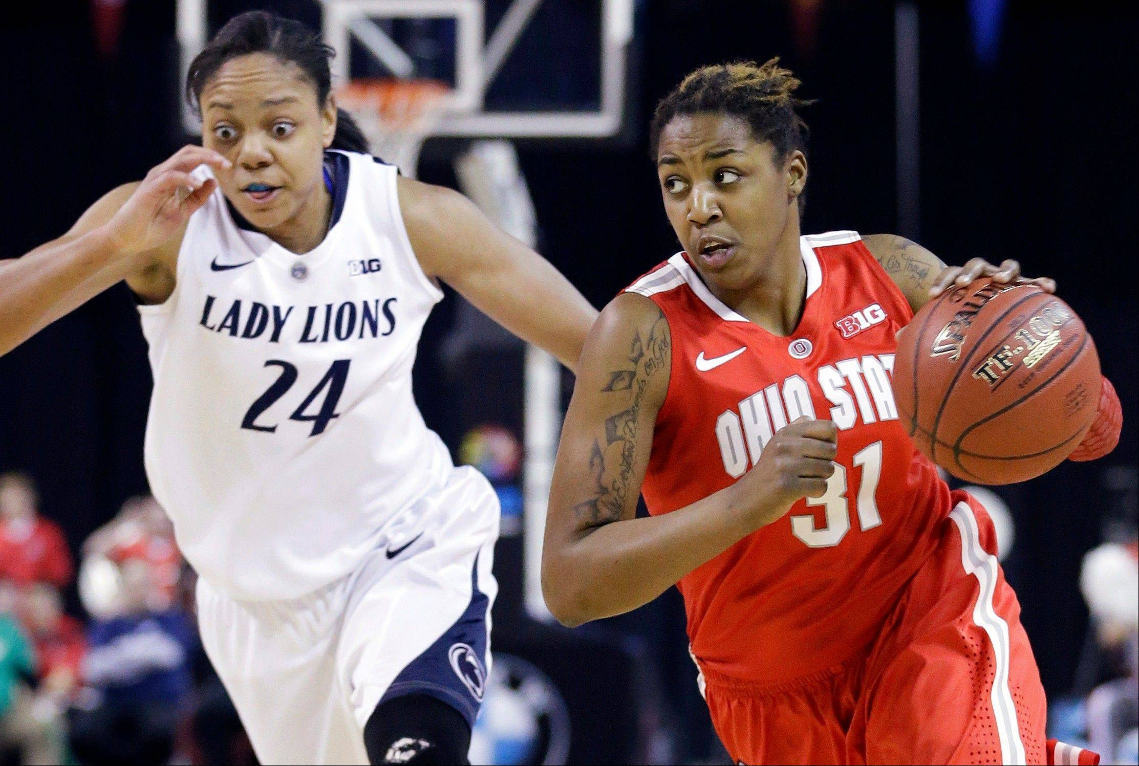 Ohio State guard Raven Ferguson, right, drives as she looks to a pass against Penn State forward Mia Nickson during the first half of an NCAA women's college basketball game in the Big Ten Conference tournament in Hoffman Estates on Friday. Among Big 10 teams, Nickson and the eighth-ranked Nittany Lions probably have the best chance to make a Final Four run this season.
