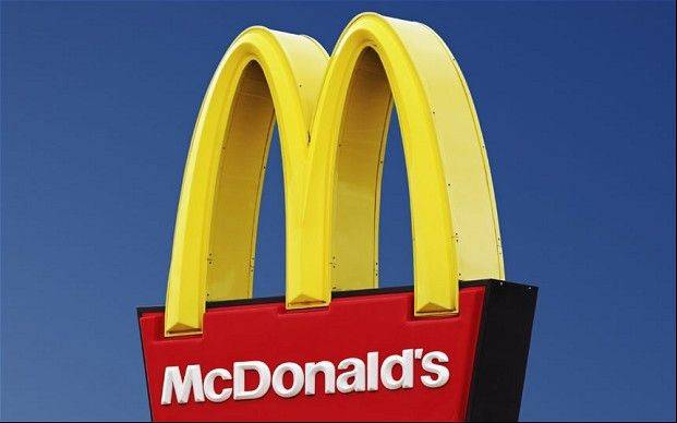 Oak Brook-based McDonald's says a monthly sales figure dipped again as it struggled with intensifying competition and challenging economic conditions around the world.