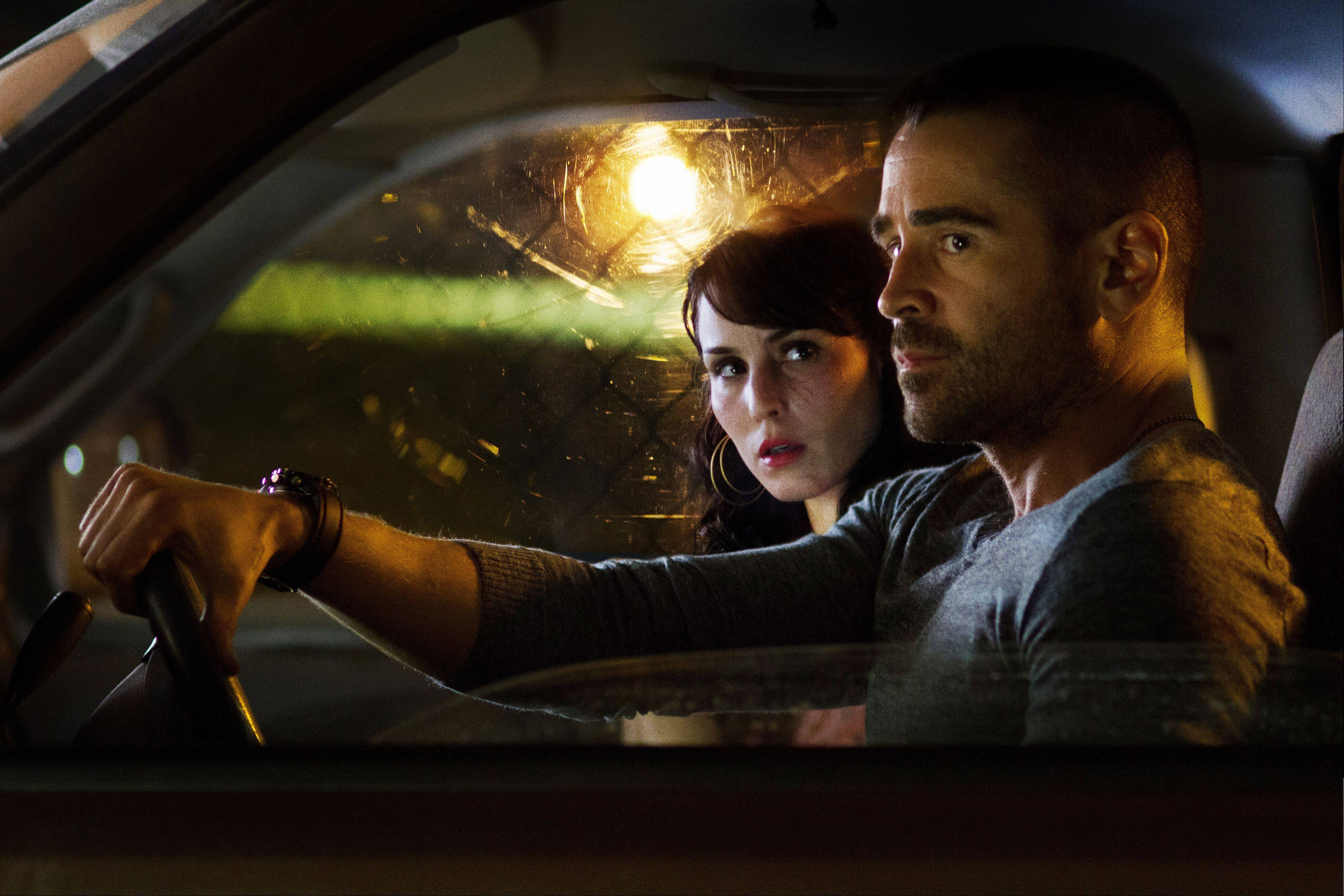 "Beatrice (Noomi Rapace), left, involves Victor (Colin Farrell) in her plans for revenge in ""Dead Man Down."""