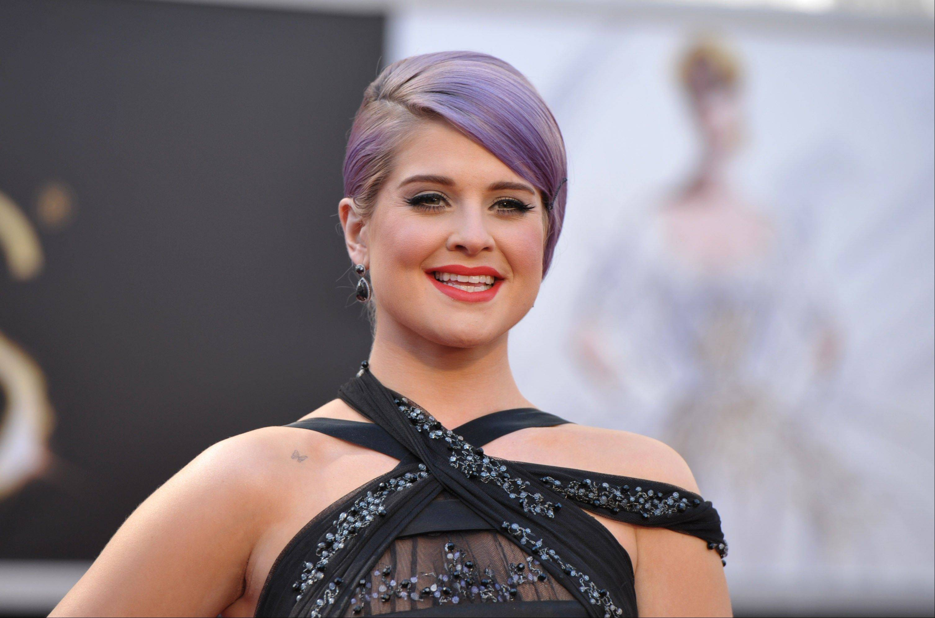 "TV personality Kelly Osbourne was hospitalized after fainting on the set of E!'s ""Fashion Police."" A spokeswoman for Osbourne told the cable network Thursday that the 28-year-old TV personality is awake, alert and in stable condition."