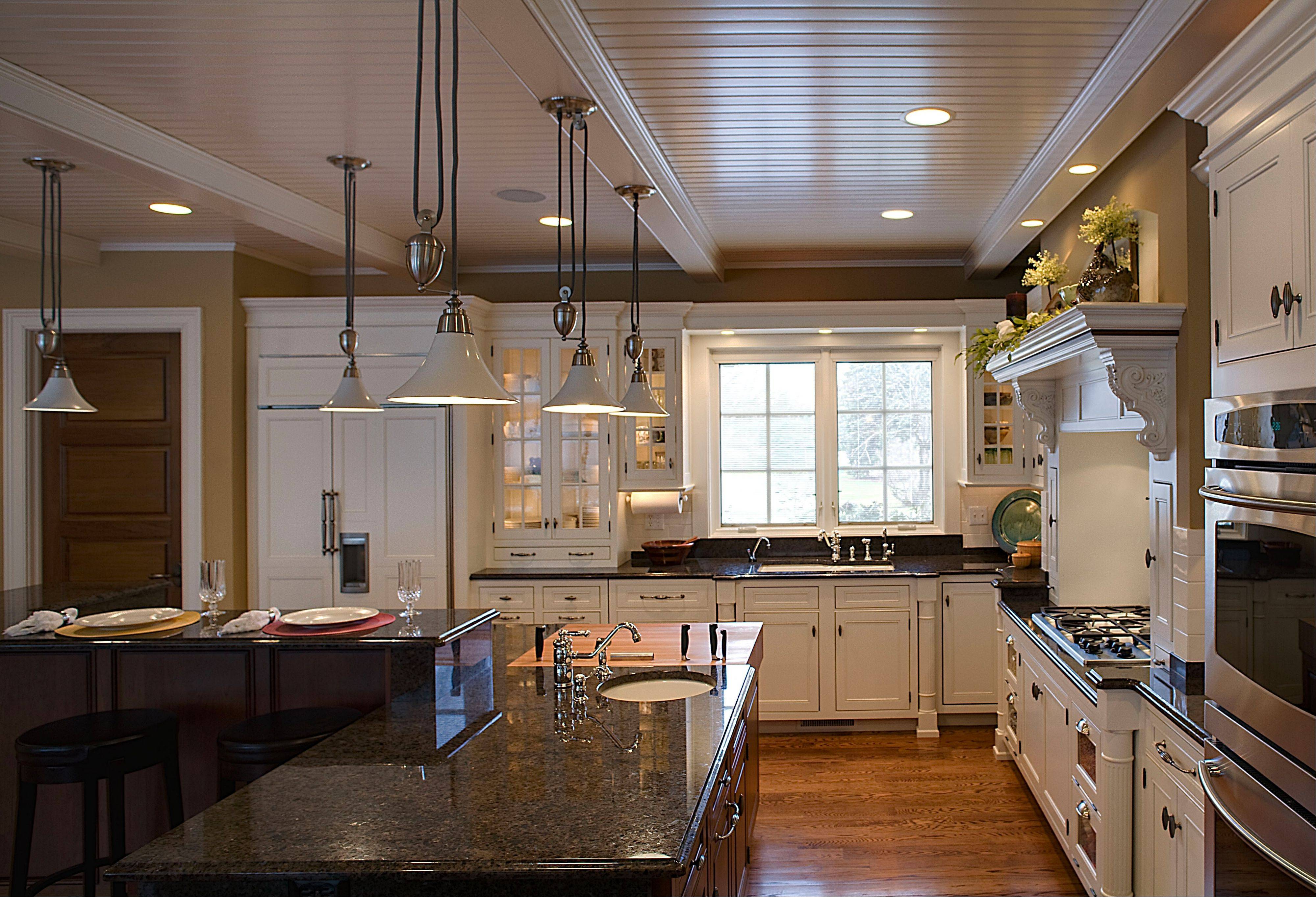 Today's larger, modern kitchens often feature a breakfast bar, a cooktop separate from ovens and furniture-quality cabinetry with lighting.