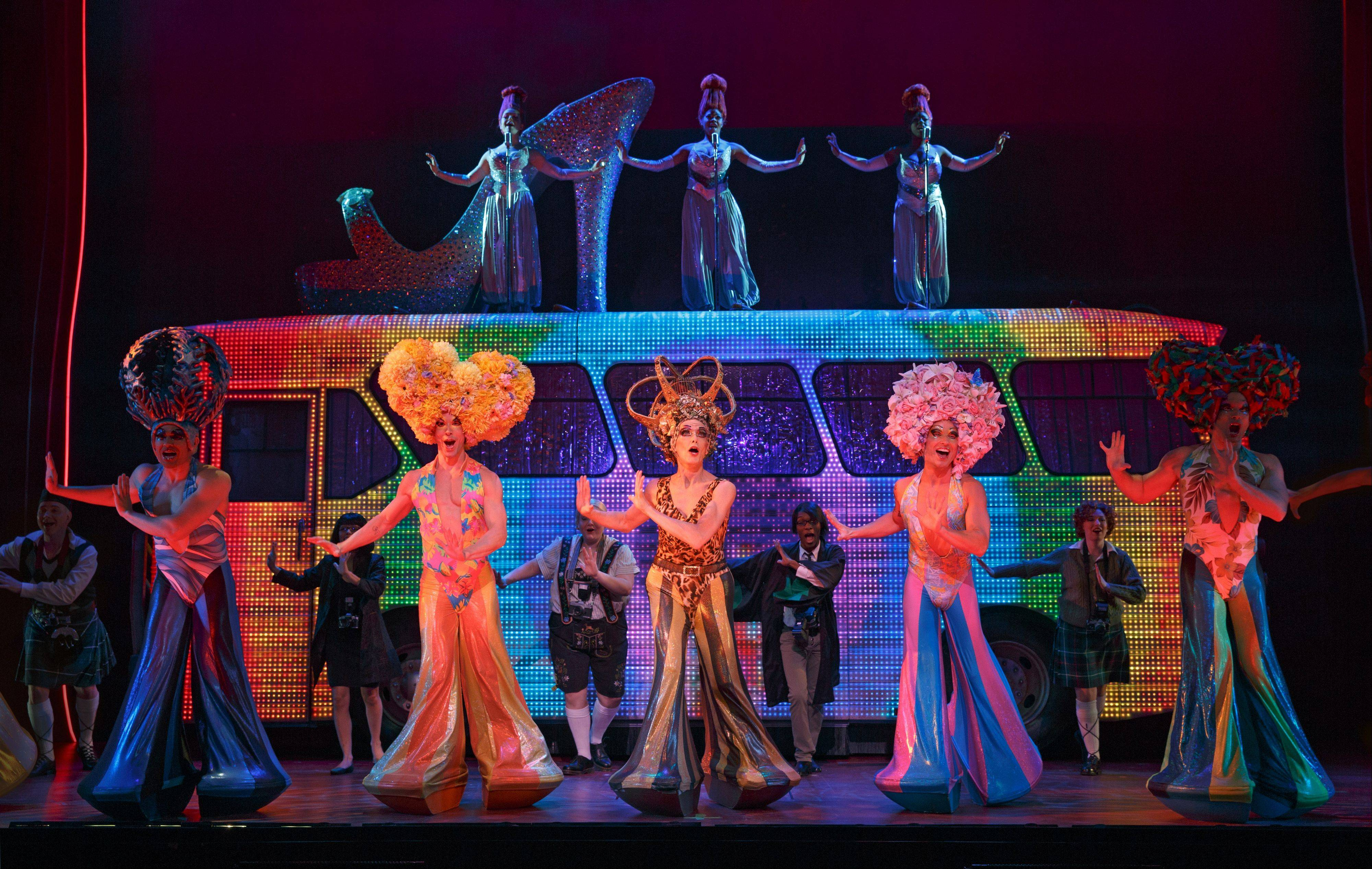"Wade McCollum, left, Scott Willis and Bryan West lead the company in ""I Will Survive"" for the flashy Act I finale of ""Priscilla Queen of the Desert The Musical."" The national tour plays the Auditorium Theatre of Roosevelt University in Chicago from Tuesday, March 19, through Saturday, March 30."