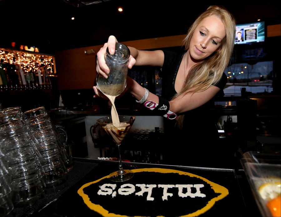 Bartender Alissa Lowery pours a Spotted Fox martini at the Spotted Fox Ale House in St. Charles. The signature cocktail is made with vanilla vodka, chocolate liqueur and a splash of Baileys with a cinnamon finish.