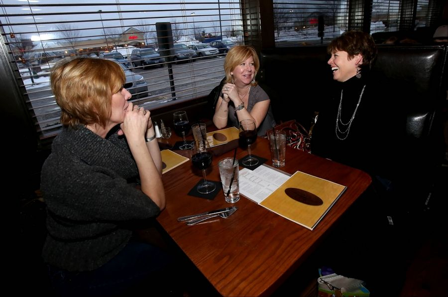 Paula Schmidt, left, Julie Keller and Julie Olney, all of St. Charles, opt for a selection of wines offered at the Spotted Fox to celebrate a recent birthday.