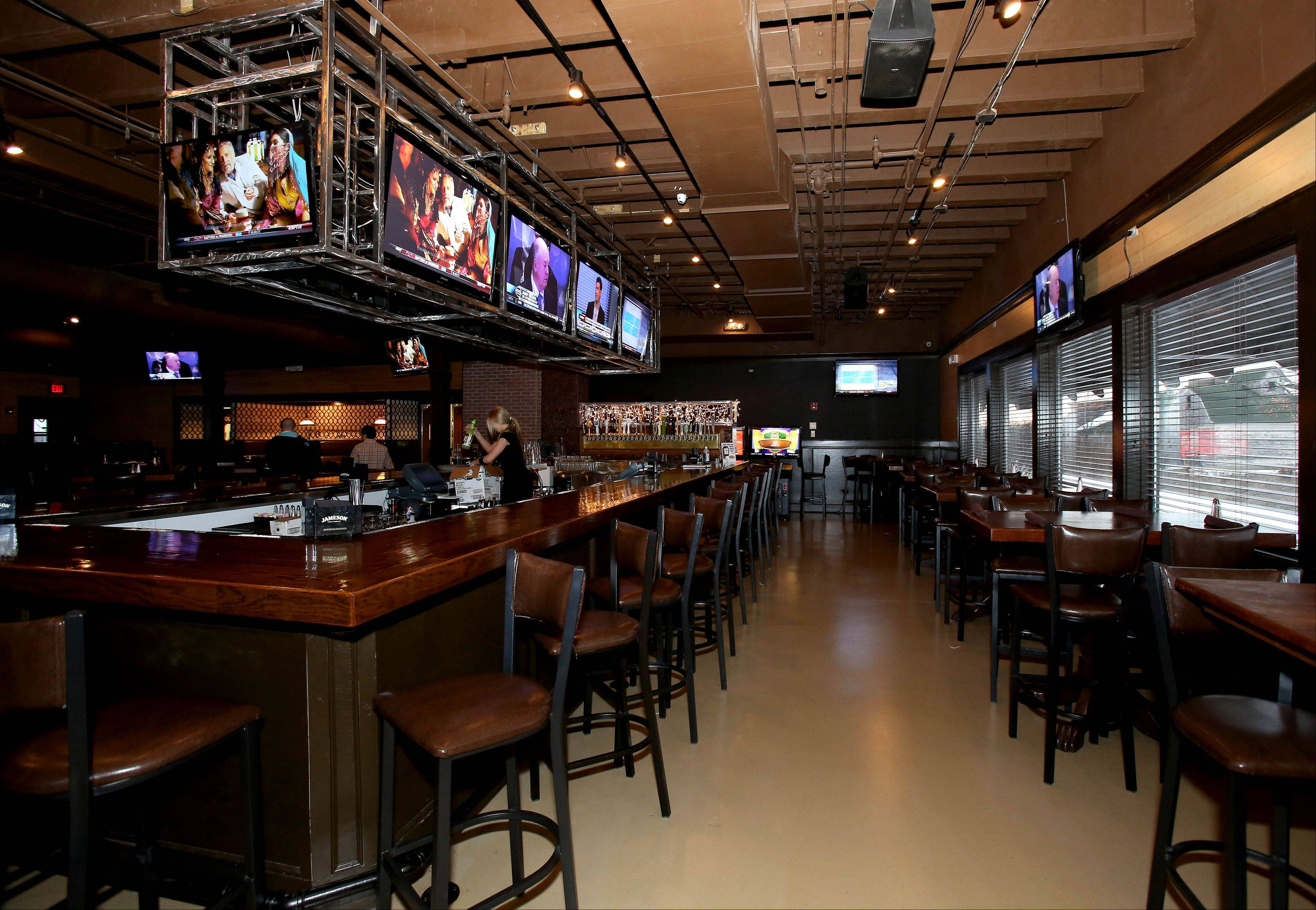 The Spotted Fox Ale House in St. Charles features a roomy bar area.