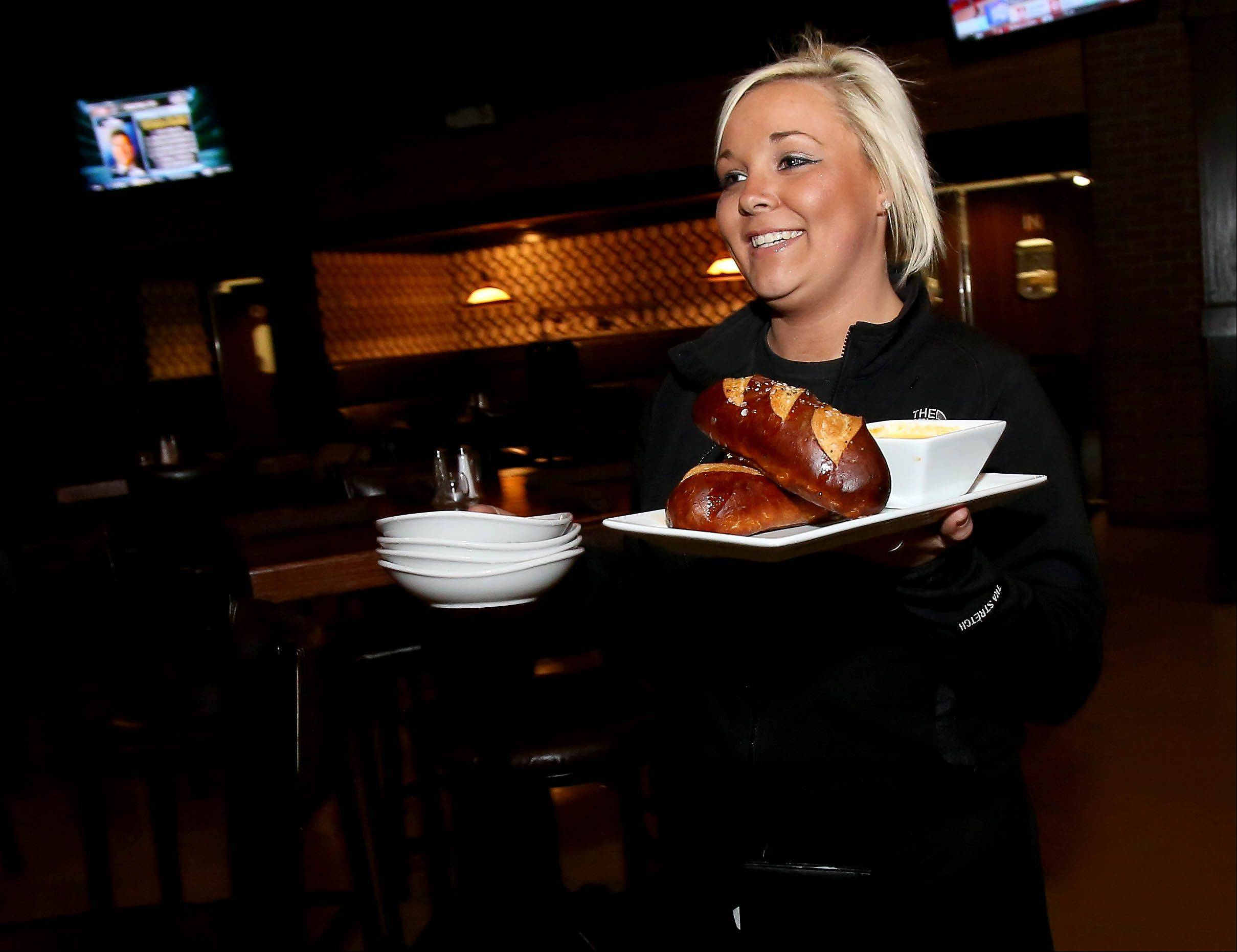 Heather Wells delivers a hot pretzel appetizer, one of the standouts on the Spotted Fox menu.