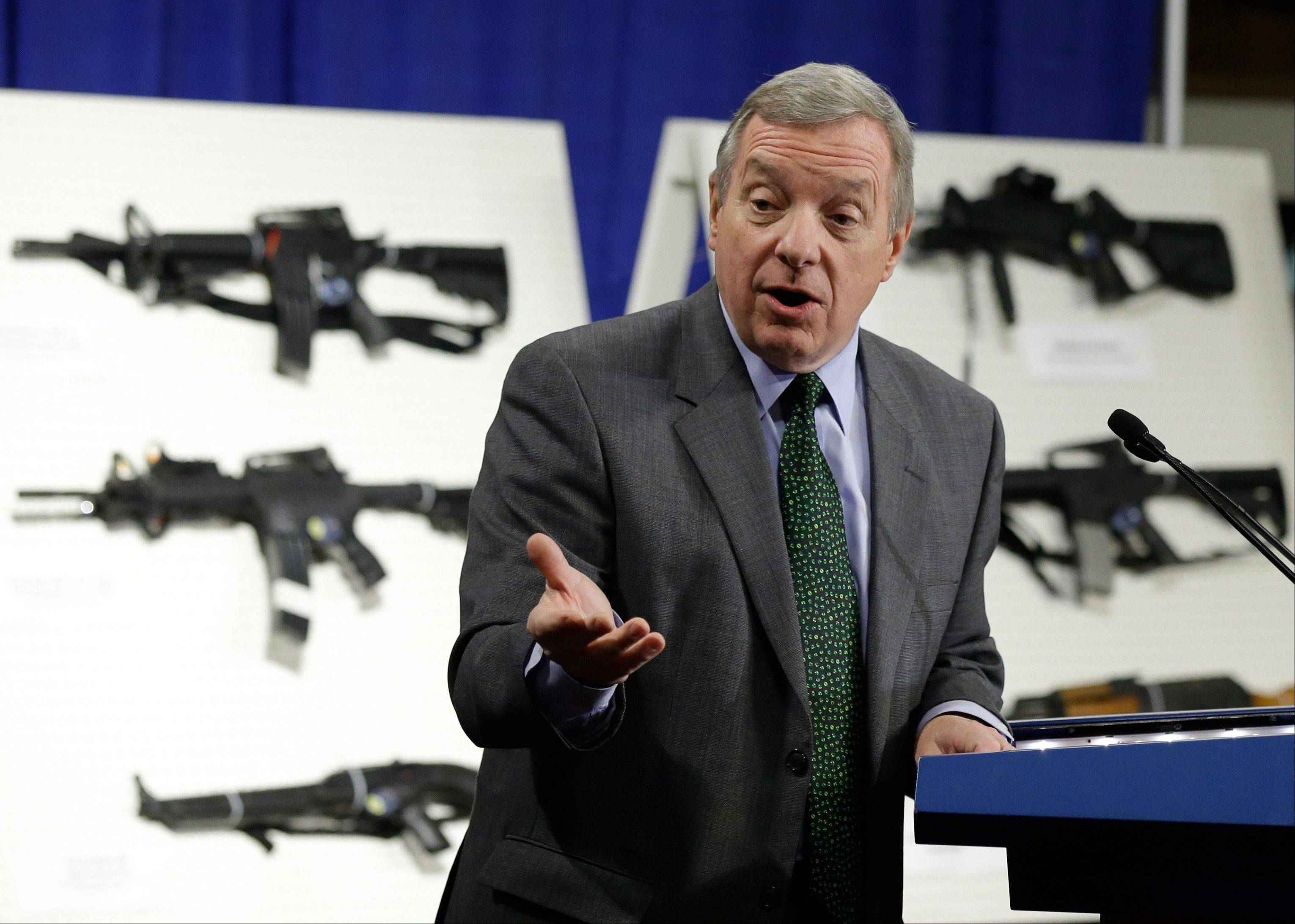 Sen. Dick Durbin speaks during a news conference on Capitol Hill to introduce legislation on assault weapons. Another bill Durbin is pushing would crack down on so-called straw purchasers, those people who buy guns legally and then provide them to criminals and others who are not legally allowed to carry them.