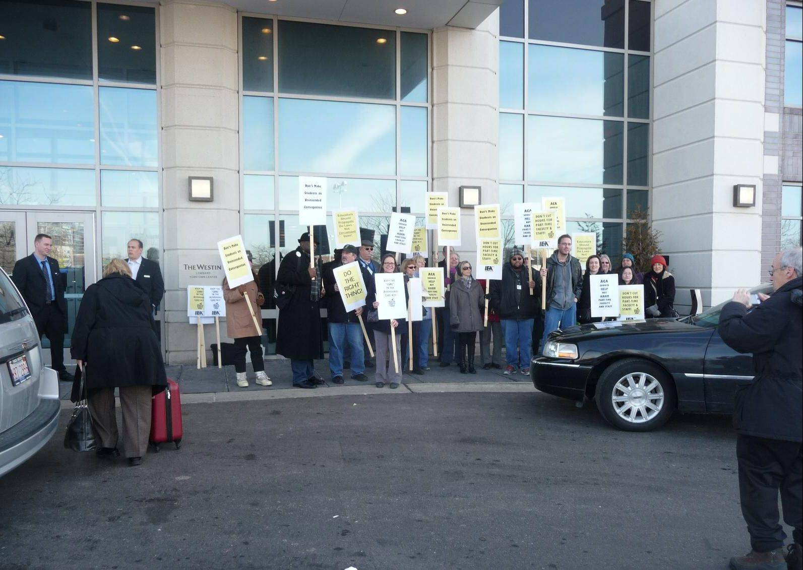 Protesters upset with cuts to part-time faculty teaching hours gather outside the Illinois Council of Community College Presidents meeting on Friday at the Westin Hotel in Lombard.