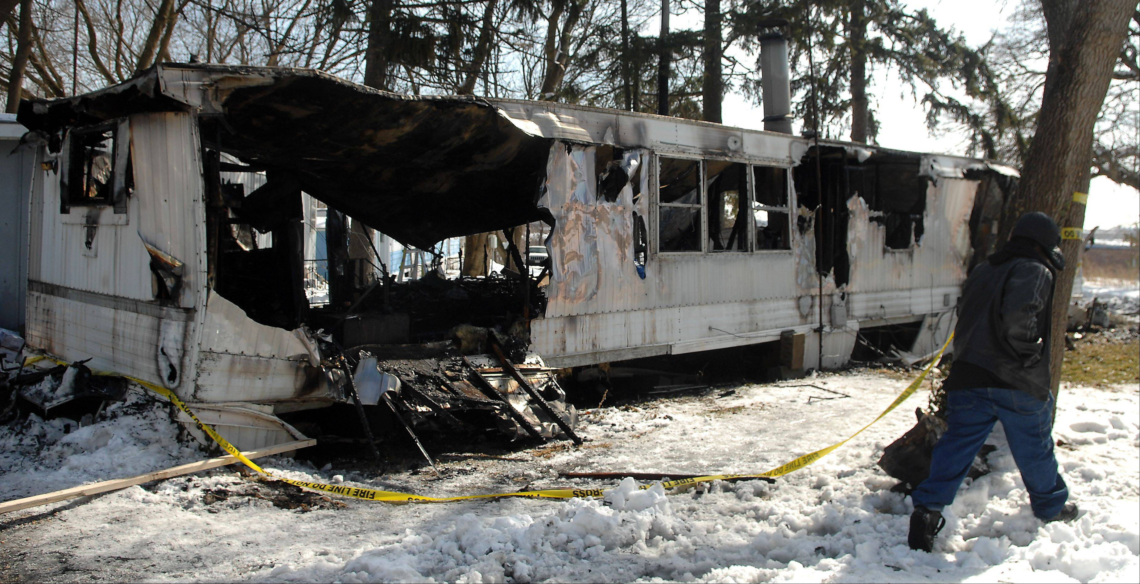 This mobile home in Elgin was destroyed in a fire early Friday; a 36-year-old man was found dead inside.