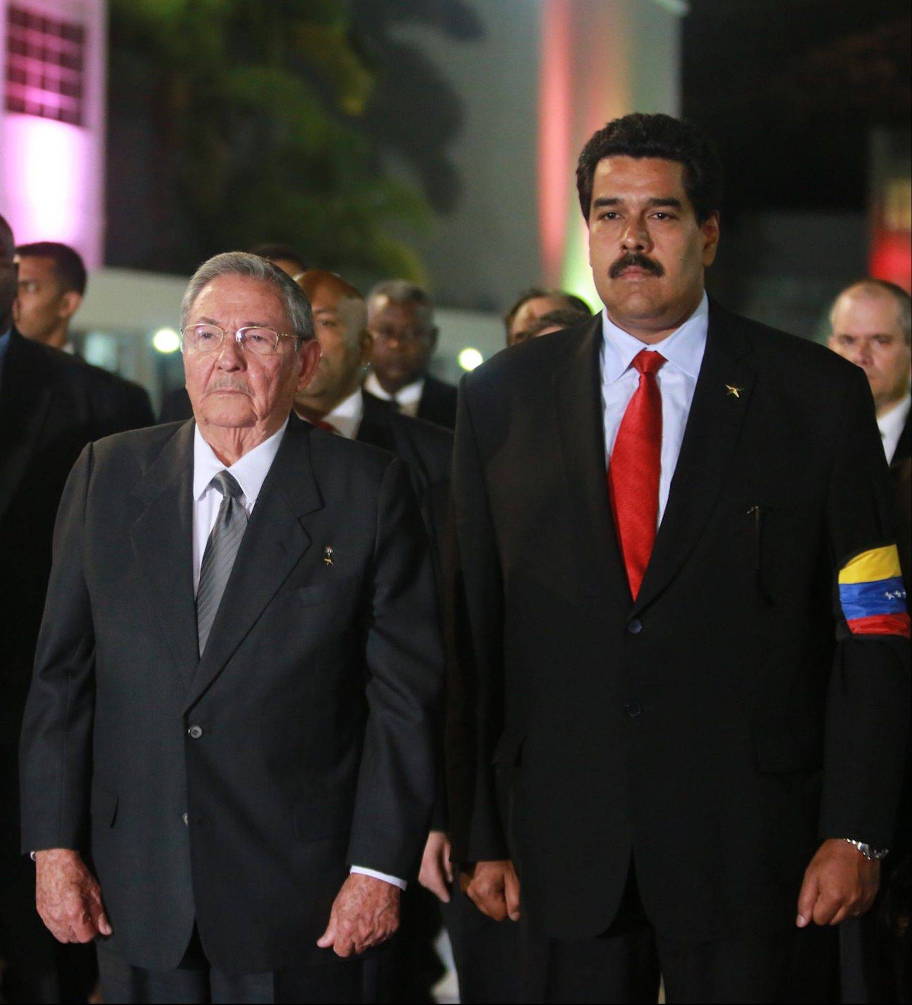 Cuba's President Raul Castro, left, and Venezuela's Vice President Nicolas Maduro stand upon their arrival to the Fort Tiuna military academy to visit the coffin containing the body of Venezuela's late President Hugo Chavez. Maduro is scheduled to be sworn in as president after Friday's funeral.