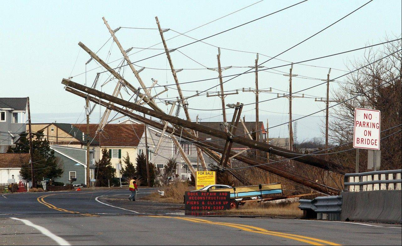 Downed utility poles on Stone Harbor Boulevard, in the Scotch Bonnet section of Middle Township, N.J., Thursday March 7, 2013 after an overnight storm. The roadway is the main access into the beach town of Stone Harbor.