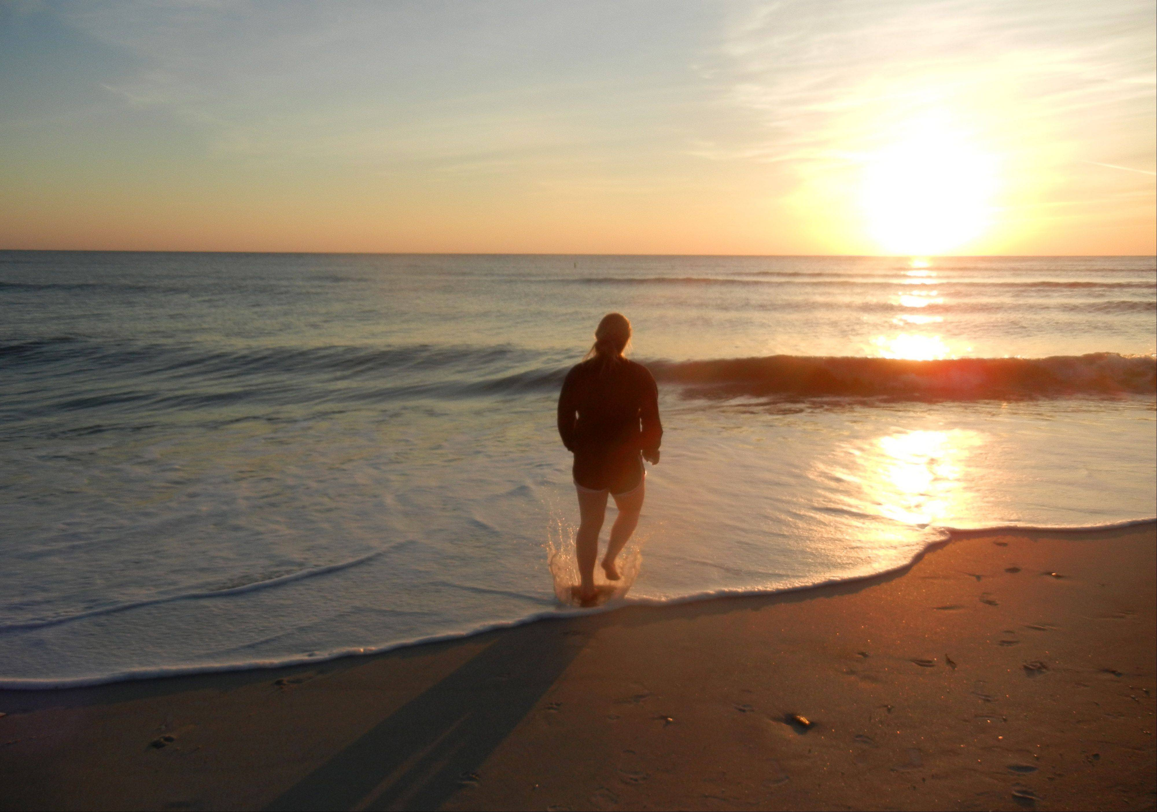 "This was my daughter Megan ""running into the sunset"" on Sanibel Island in Florida this past December."