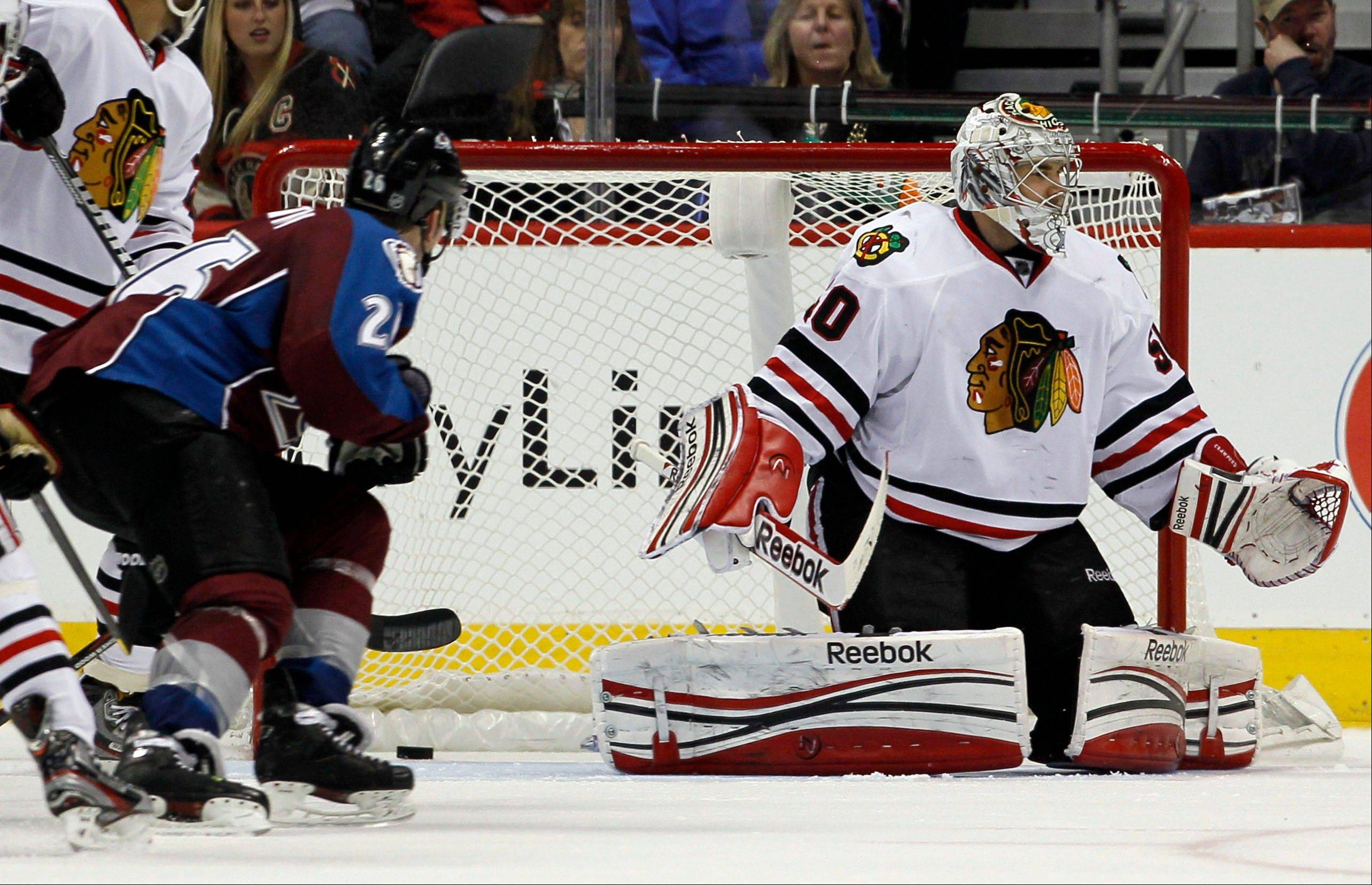 Chicago Blackhawks goalie Corey Crawford, right, reacts after letting in a goal by Colorado Avalanche center Ryan O'Reilly .