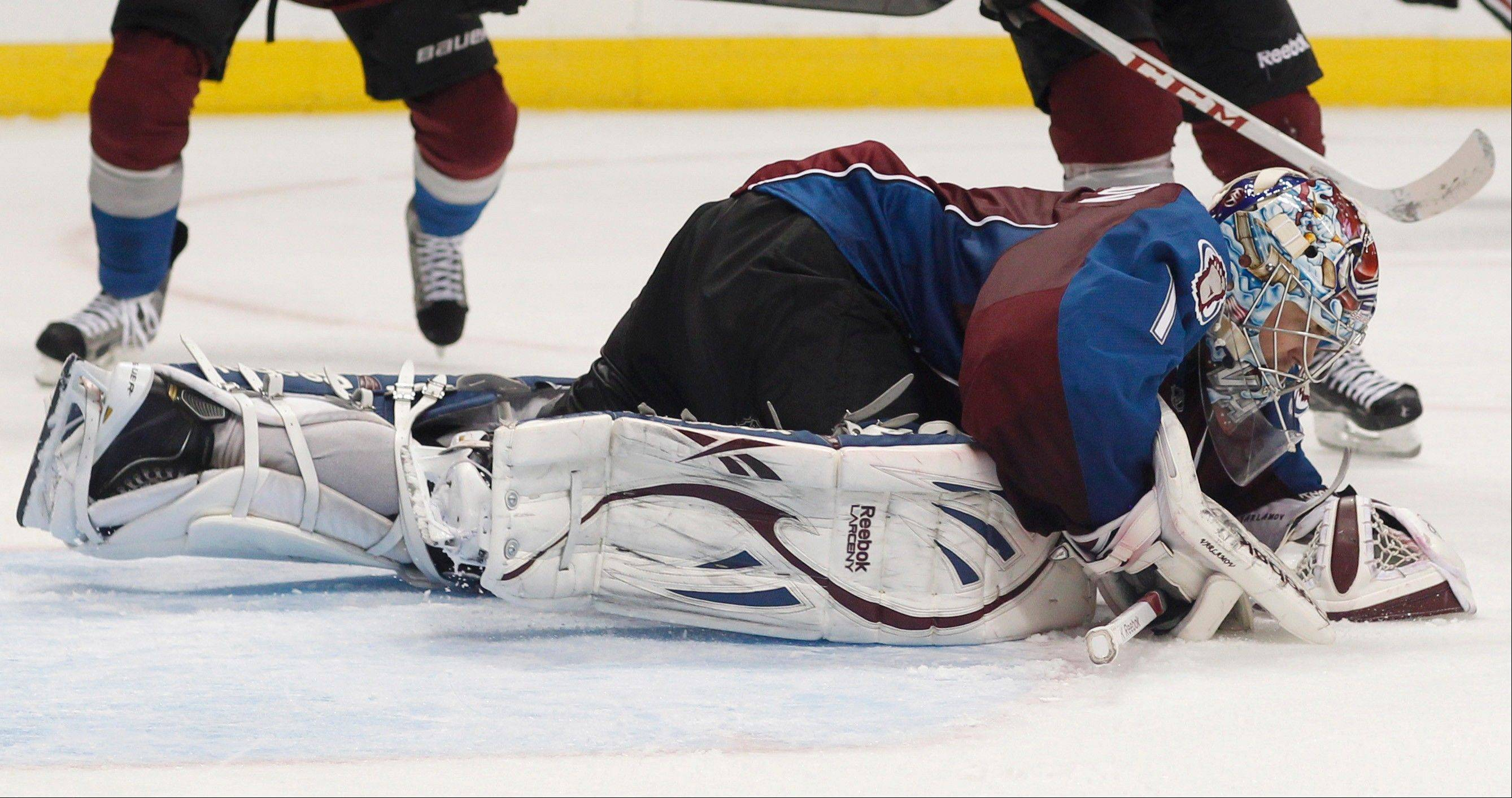 Colorado Avalanche goalie Semyon Varlamov, of Russia, drops on the ice to cover the puck after stopping a shot from the Chicago Blackhawks in the second period.