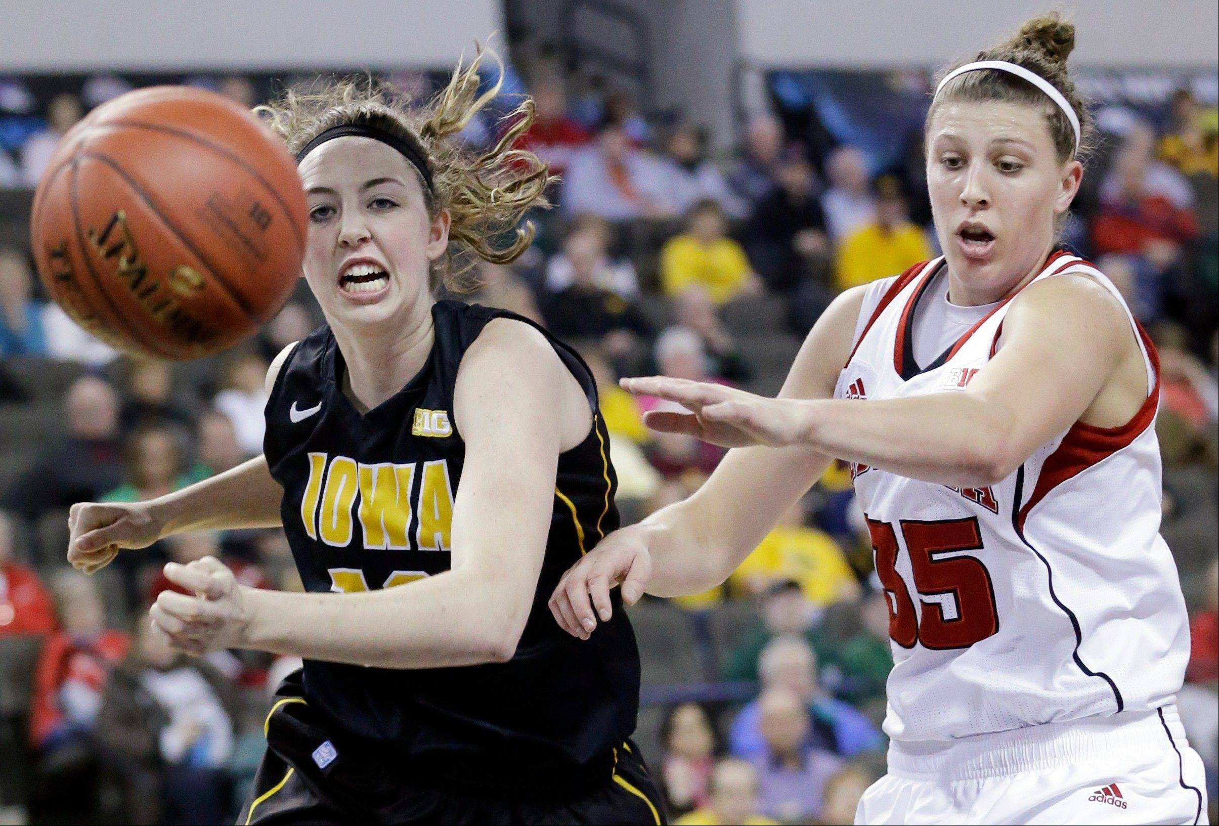 Iowa center Morgan Johnson, left, and Nebraska forward Jordan Hooper chase the ball during the first half of an NCAA college basketball game in the Big Ten Conference tournament in Hoffman Estates, Ill., on Friday, March 8, 2013.