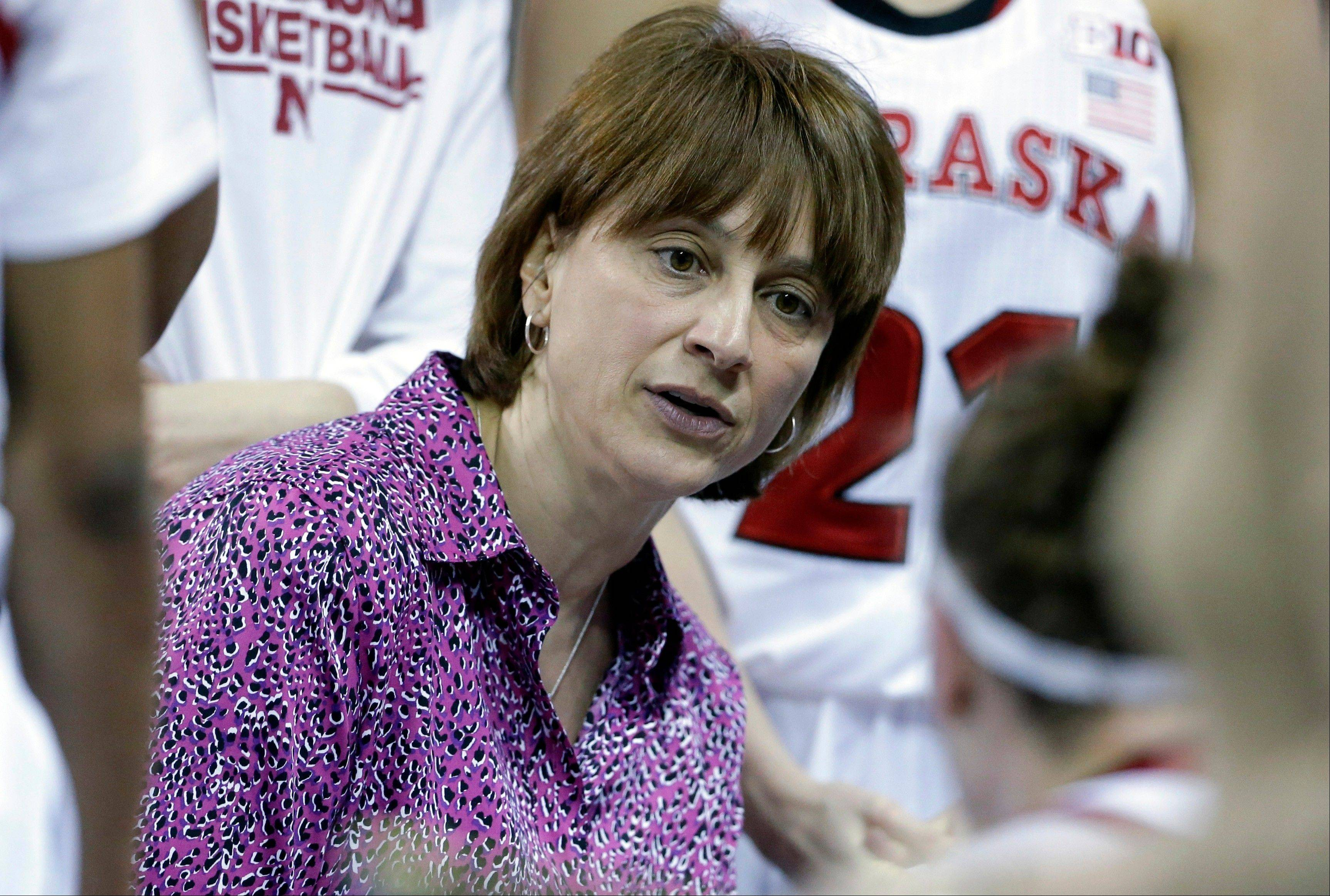Nebraska head coach Connie Yori talks to her team during the second half of an NCAA college basketball game against Iowa in the Big Ten Conference tournament in Hoffman Estates, Ill., on Friday, March 8, 2013. Nebraska won 76-61.