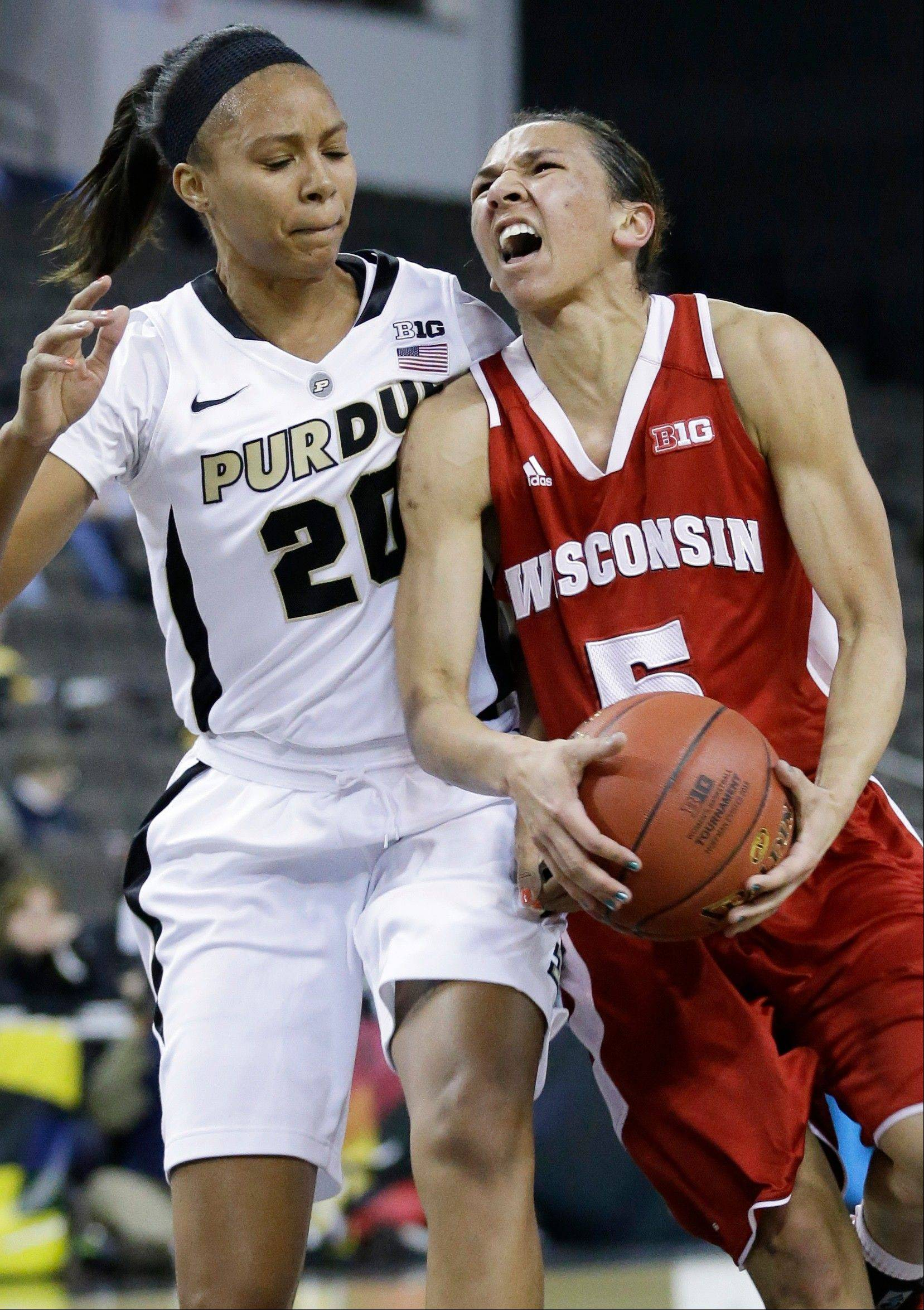 Wisconsin guard Morgan Paige, right, drives to the basket against Purdue guard Dee Dee Williams during the first half of an NCAA college basketball game in the Big Ten Conference tournament in Hoffman Estates, Ill., on Friday, March 8, 2013.