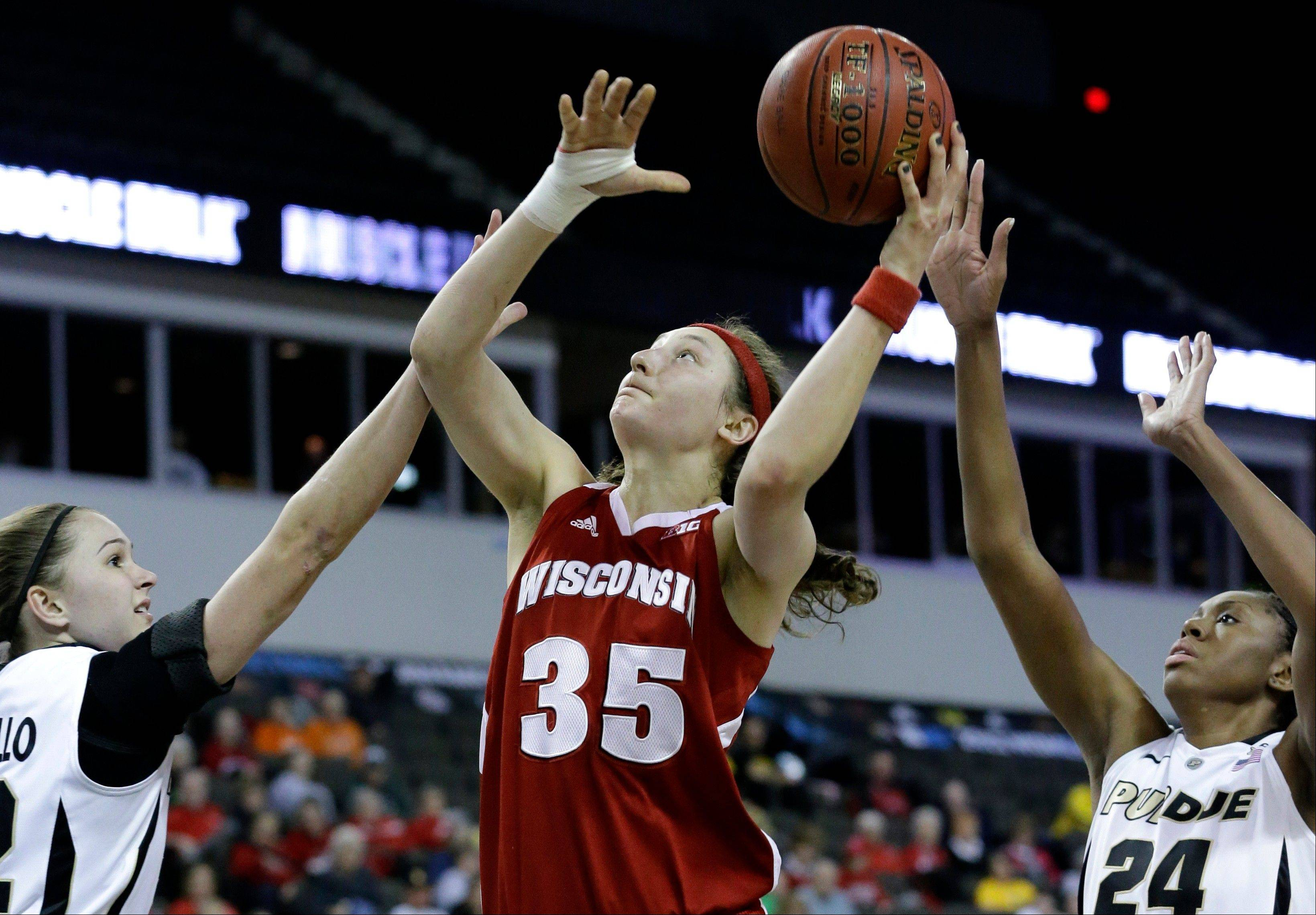 Wisconsin forward Jacki Gulczynski (35) shoots against Purdue forward Sam Ostarello, left, and Drey Mingo, right, during the first half of an NCAA college basketball game in the Big Ten Conference tournament in Hoffman Estates, Ill., on Friday, March 8, 2013.