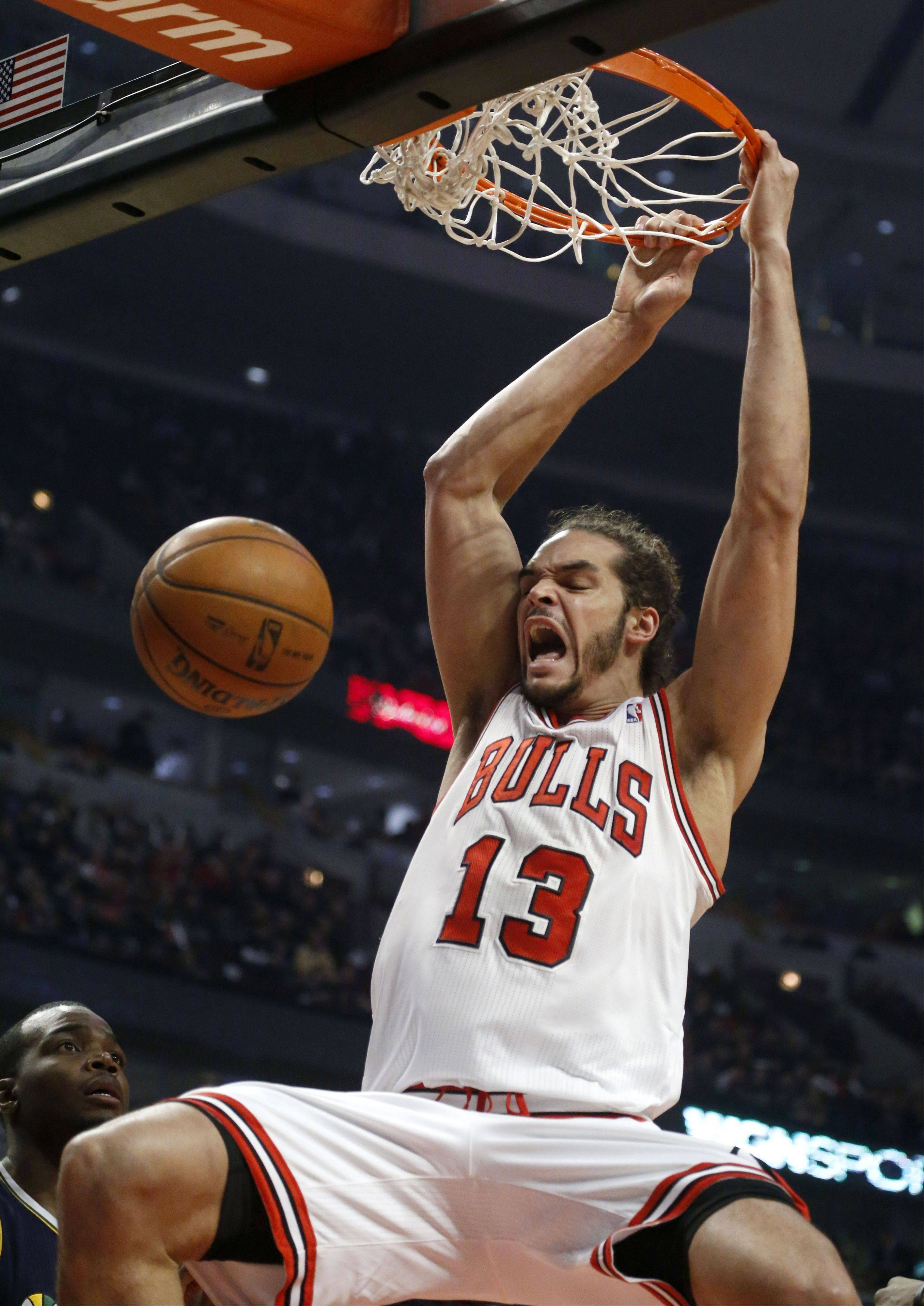 Chicago Bulls center Joakim Noah dunks during the first half of an NBA basketball game against the Utah Jazz, Friday, March 8, 2013, in Chicago.