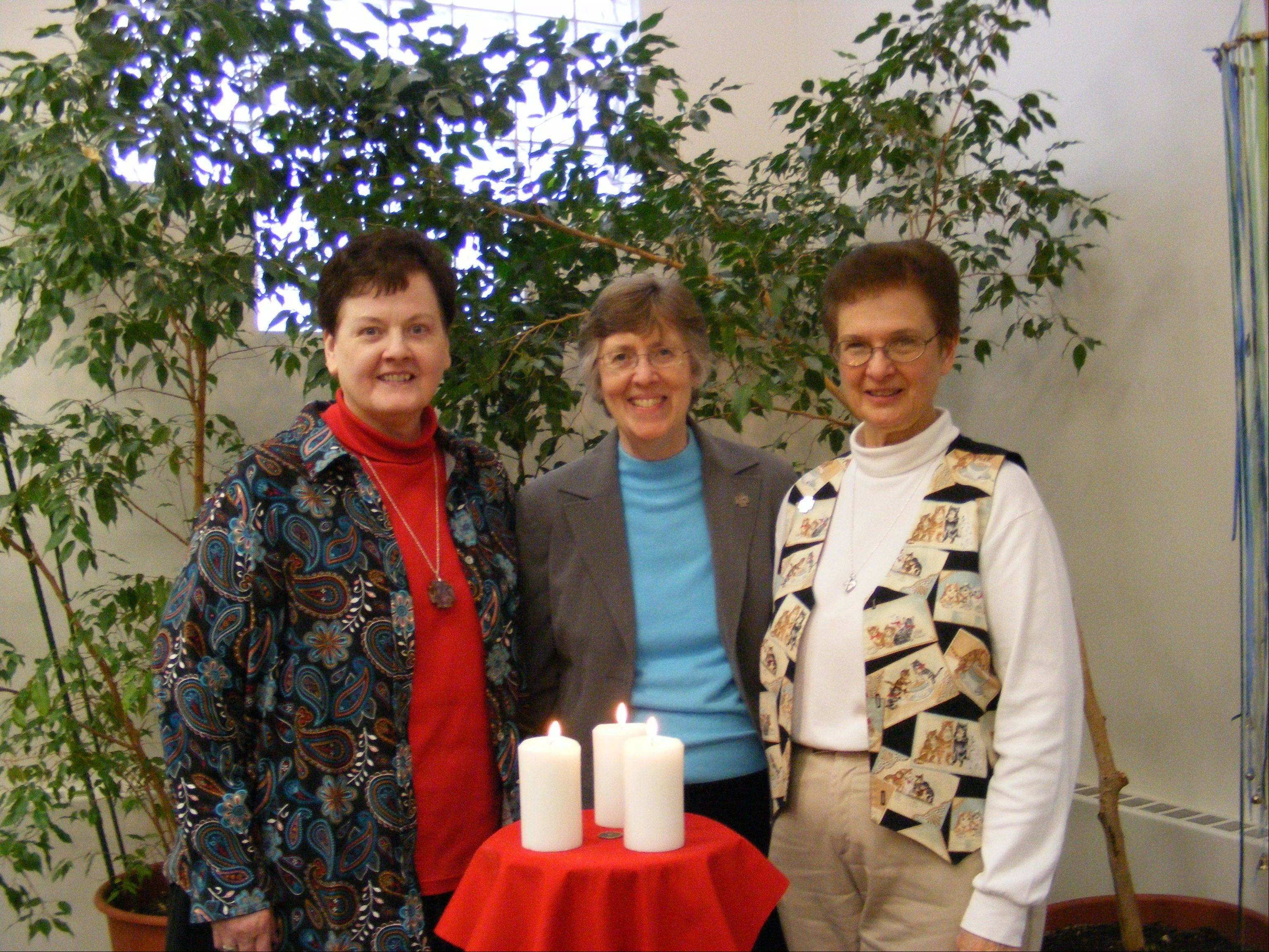 Sisters Kathleen, Kristine and Sharon share in prayer at the close of the assembly of the Sisters of the Living Word on Sunday, Feb. 10, at the Living Word Center in Arlington Heights.