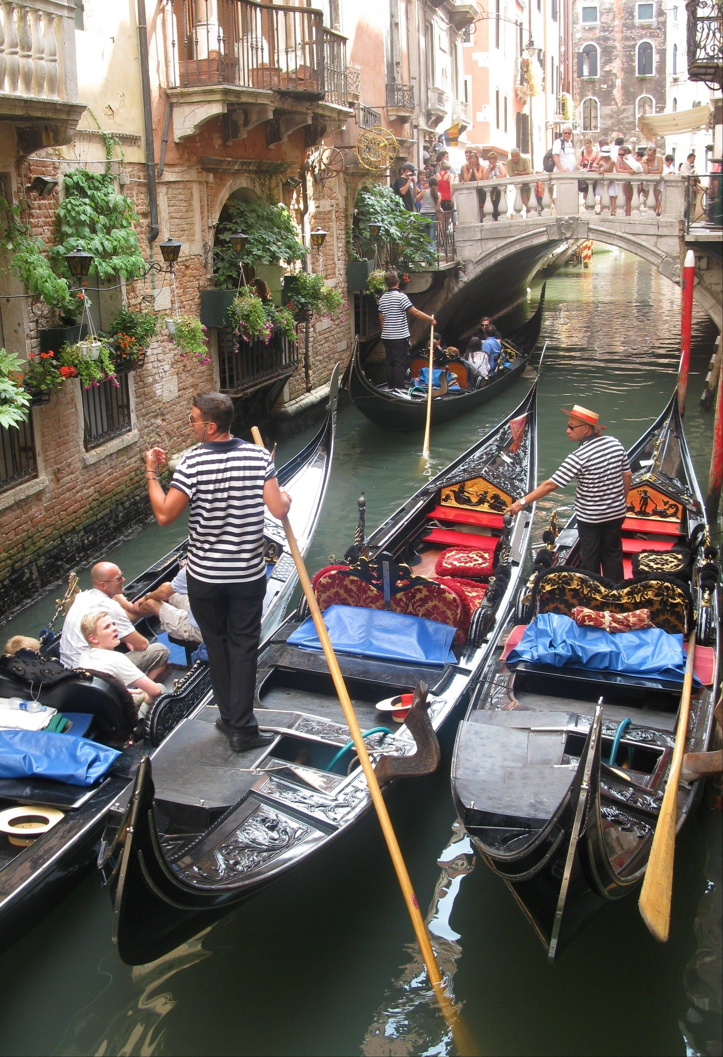 "Gondolas bunch up in a traffic jam on the narrow canals of Venice. Some travelers head to Italy inspired by Mark Twain's ""The Innocents Abroad,"" his classic ""record of a pleasure trip."""