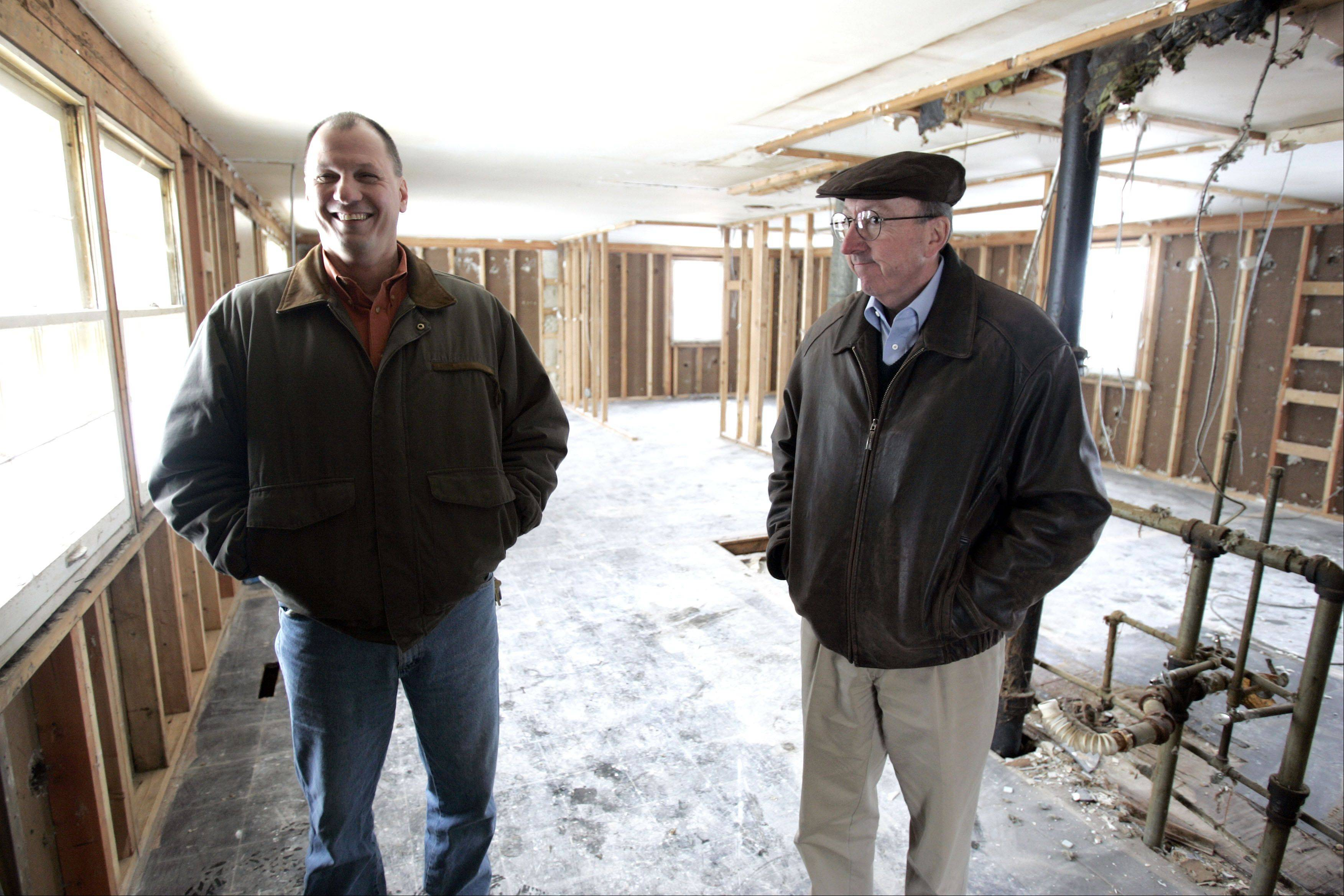 OTTO Engineering facilities manager Jerry Skowronski, left, and Tom Roeser, owner of Homes by OTTO, in one of the homes that the companies are working to rehab for resale in the Carpentersville area.