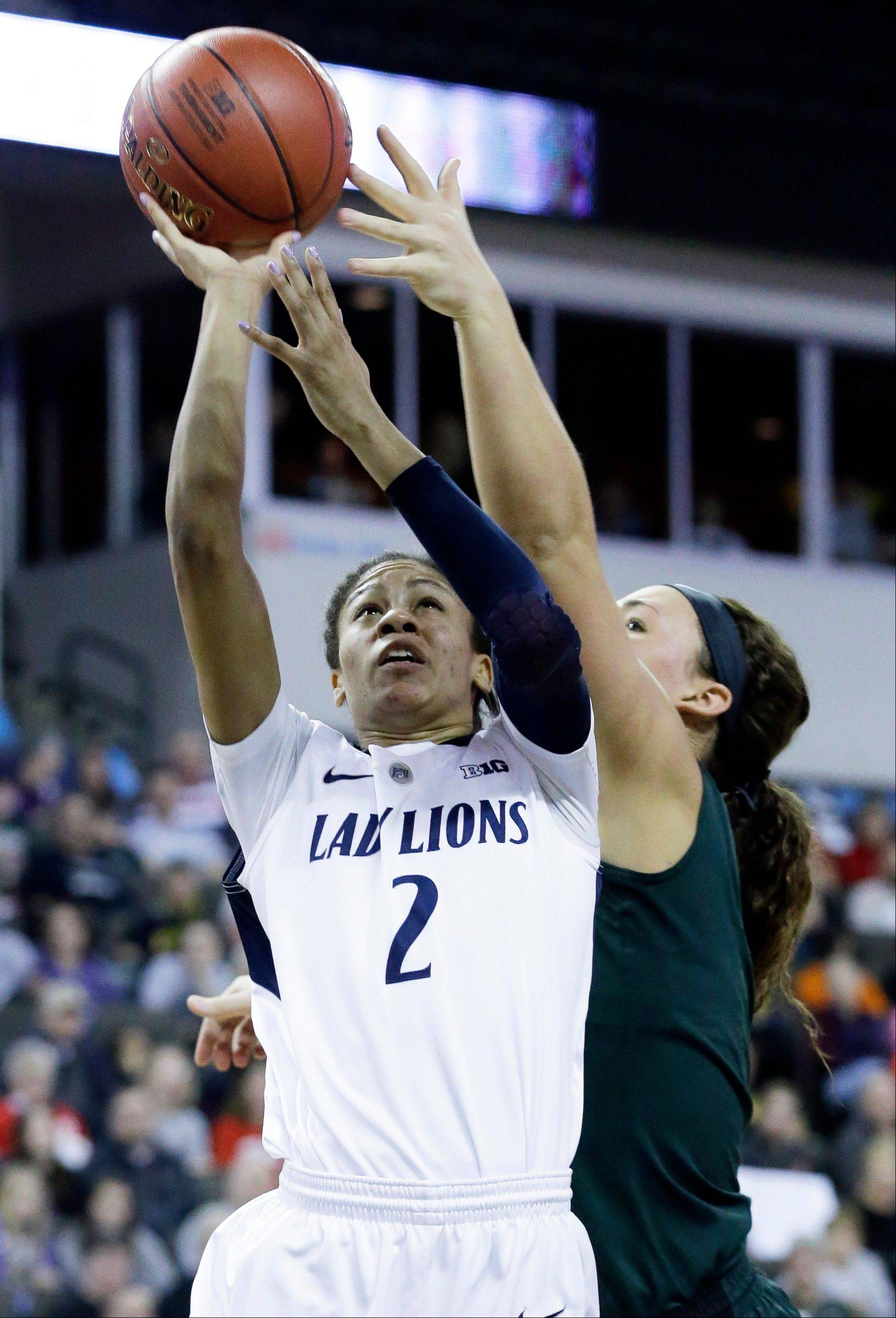 Penn State guard Dara Taylor, left, shoots as Michigan State center Jasmine Hines guards during the second half of an NCAA college basketball game in the Big Ten Conference tournament in Hoffman Estates, Ill., Saturday, March 9, 2013. Michigan State won 54-46. (AP Photo/Nam Y. Huh)