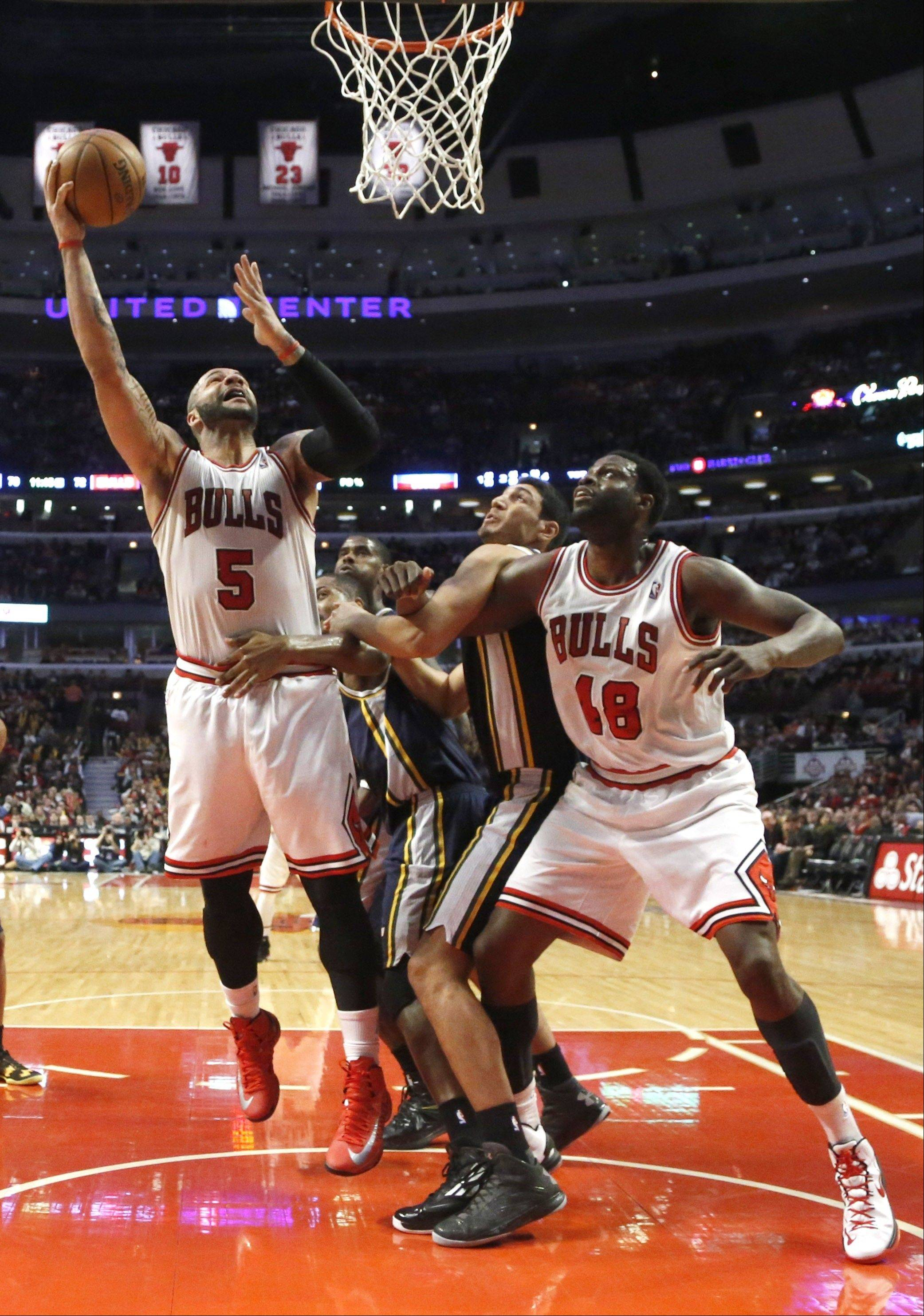 Bulls center Nazr Mohammed blocks out Utah�s Enes Kanter as Carlos Boozer scores during the second half of Friday�s victory over the Jazz.