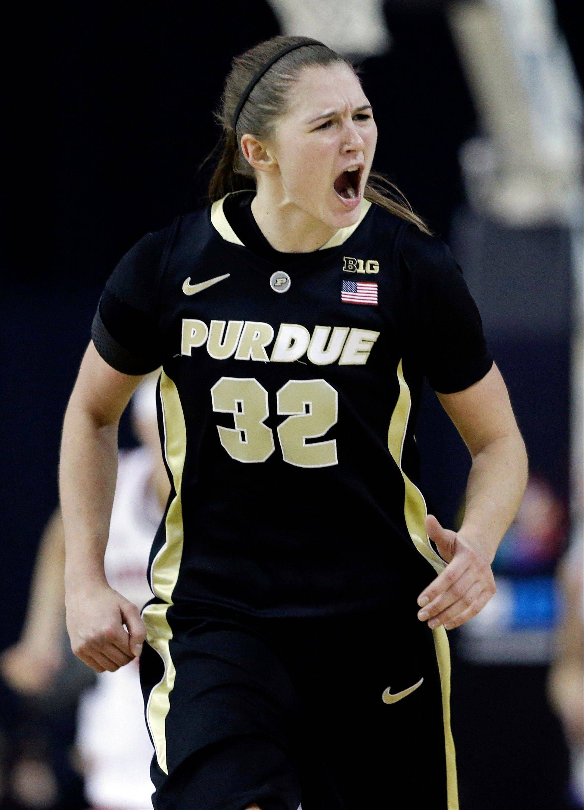 Purdue forward Sam Ostarello reacts after scoring a basket during the second half of an NCAA college basketball game against Nebraska in the Big Ten Conference tournament in Hoffman Estates, Ill., Saturday, March 9, 2013. Purdue won 77-64. (AP Photo/Nam Y. Huh)