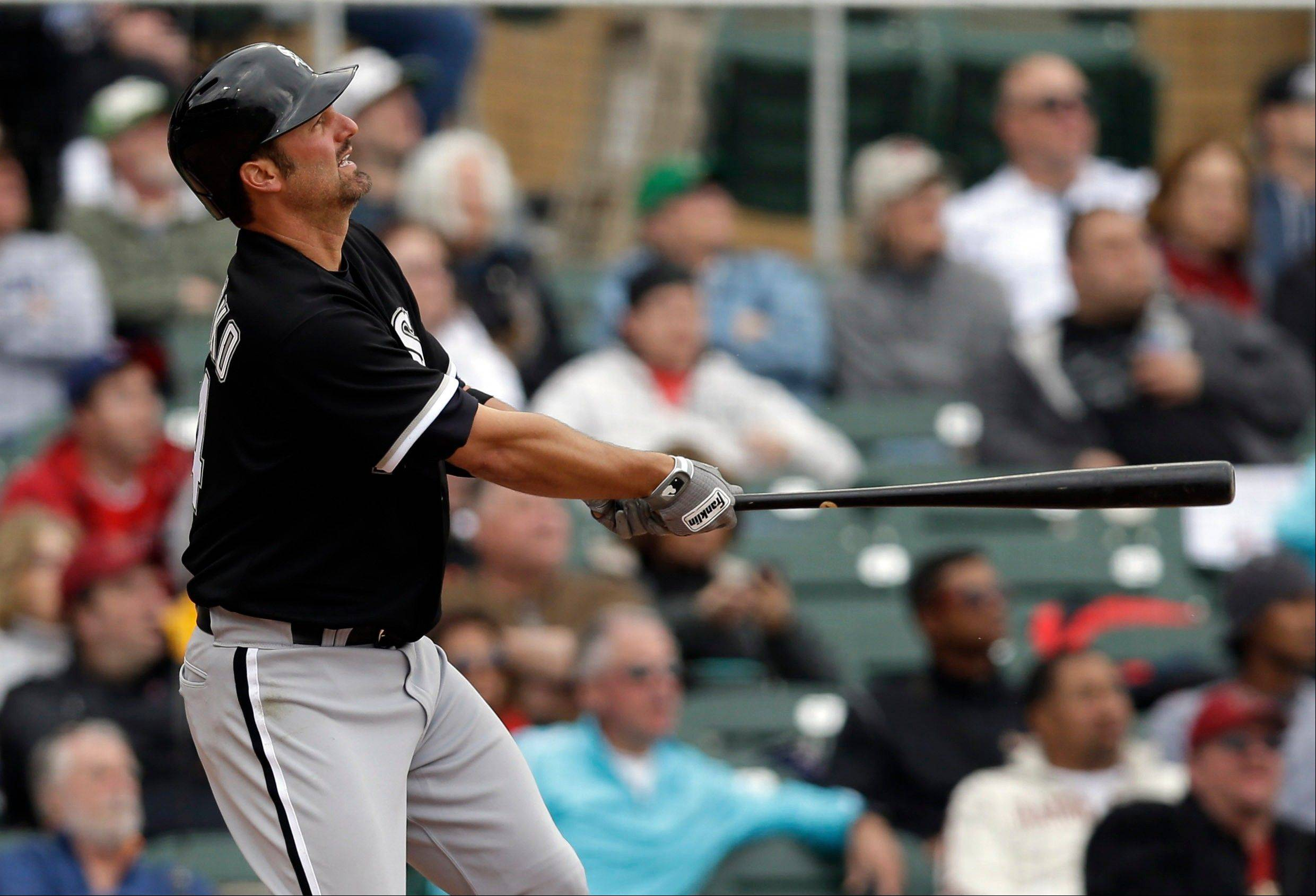Chicago White Sox's Paul Konerko watches his three-run home run against the Arizona Diamondbacks during the fifth inning of an exhibition spring training baseball game on Saturday, March 9, 2013 in Scottsdale, Ariz. (AP Photo/Marcio Jose Sanchez)