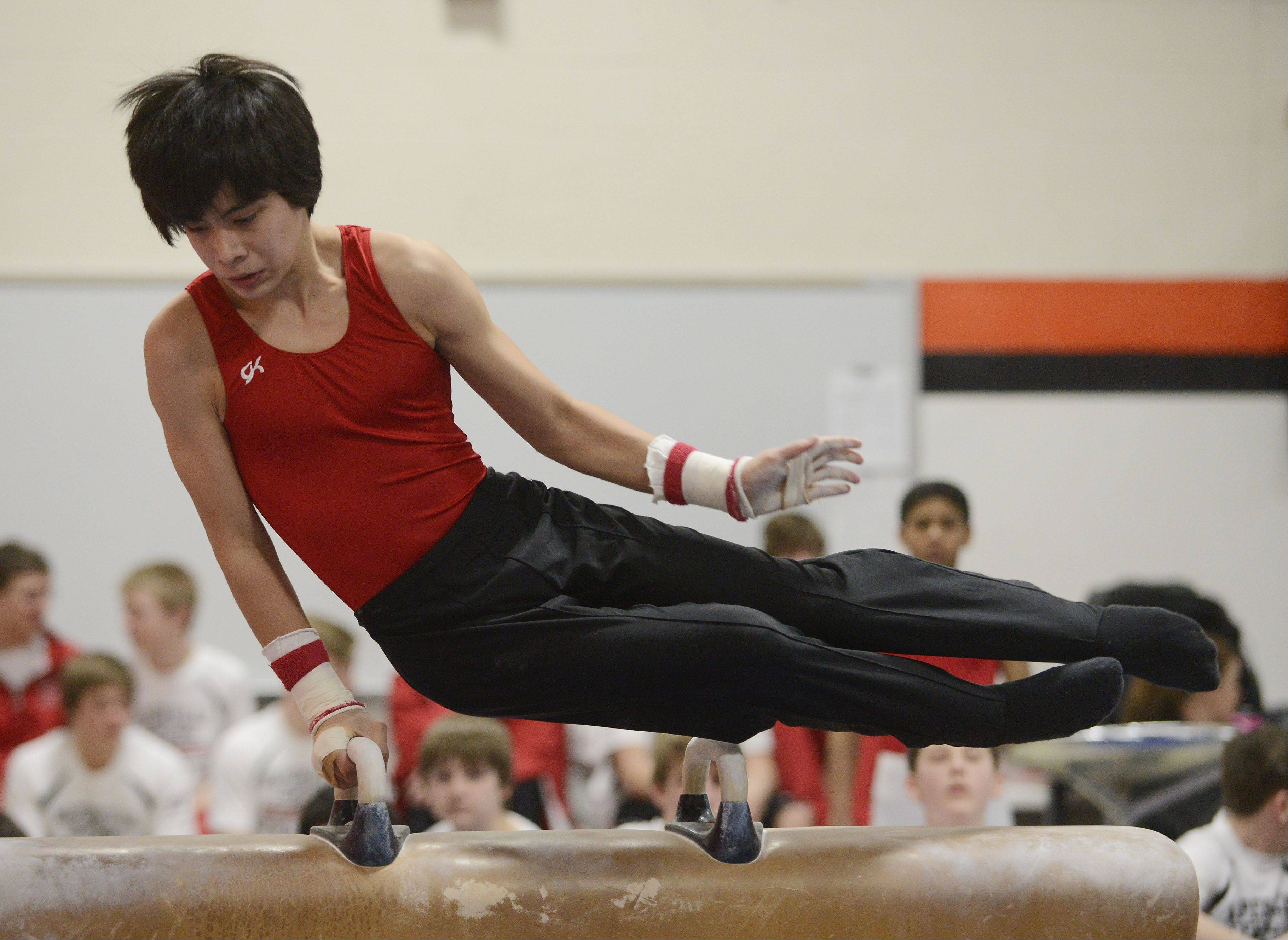 Naperville Central�s Keenan Oshiro competes on the pommel horse during Saturday�s boys gymnastics meet at Libertyville High School.
