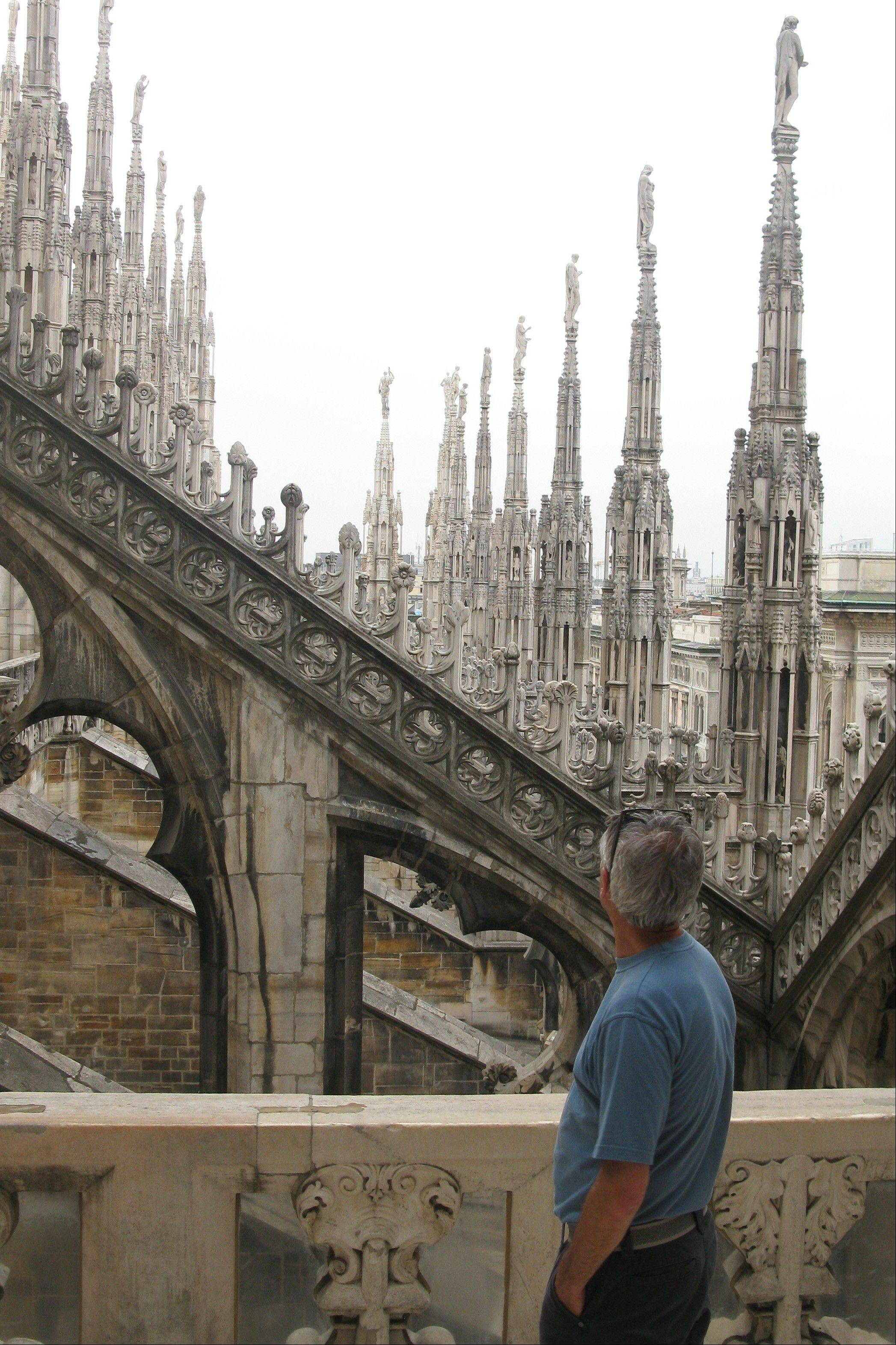 "A man looks at the spires of the Milan cathedral. Mark Twain's 1869 ""The Innocents Abroad"" inspires some people to travel abroad."
